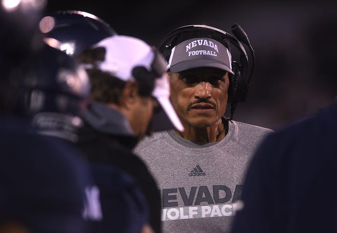 Nevada head coach Jay Norvell walks the sideline during his team's game against Fresno State.
