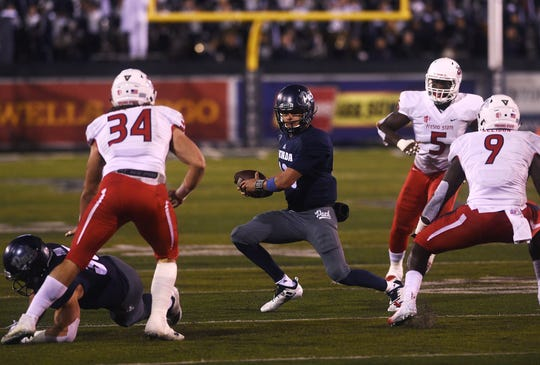 Nevada's Cristian Solano (13) looks for room to run while  taking on Fresno St. during their football game at Mackay Stadium in Reno on Oct. 6, 2018.