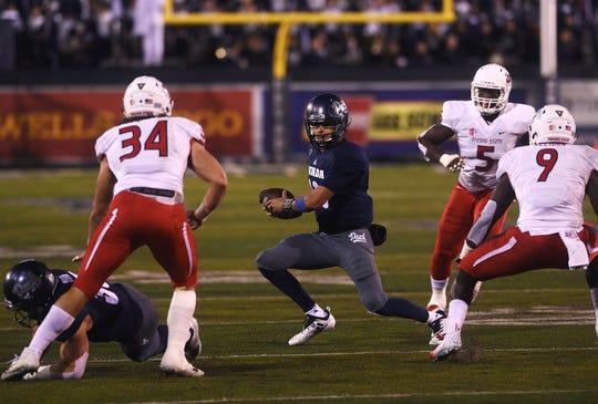 Nevada quarterback Cristian Solano looks for running room against Fresno State.