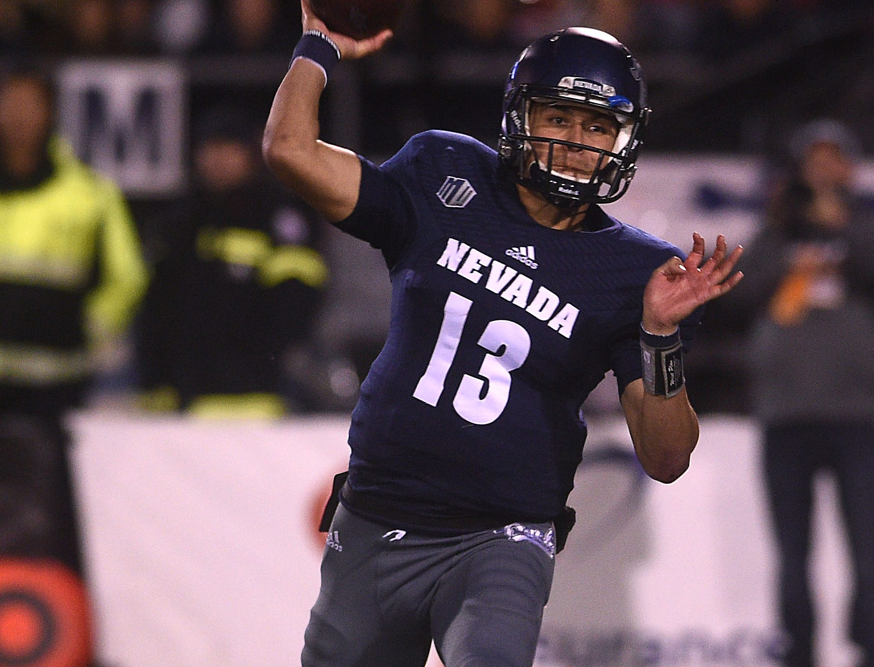 Nevada's Cristian Solano (13) makes a pass while taking on Fresno St. during their football game at Mackay Stadium in Reno on Oct. 6, 2018.