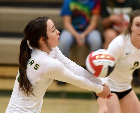 Bishop Manogue's Ava Loos sets up the ball against Spanish Springs at Manogue  on Sept. 18, 2018. Manogue defeated  Spanish Springs 3-0.