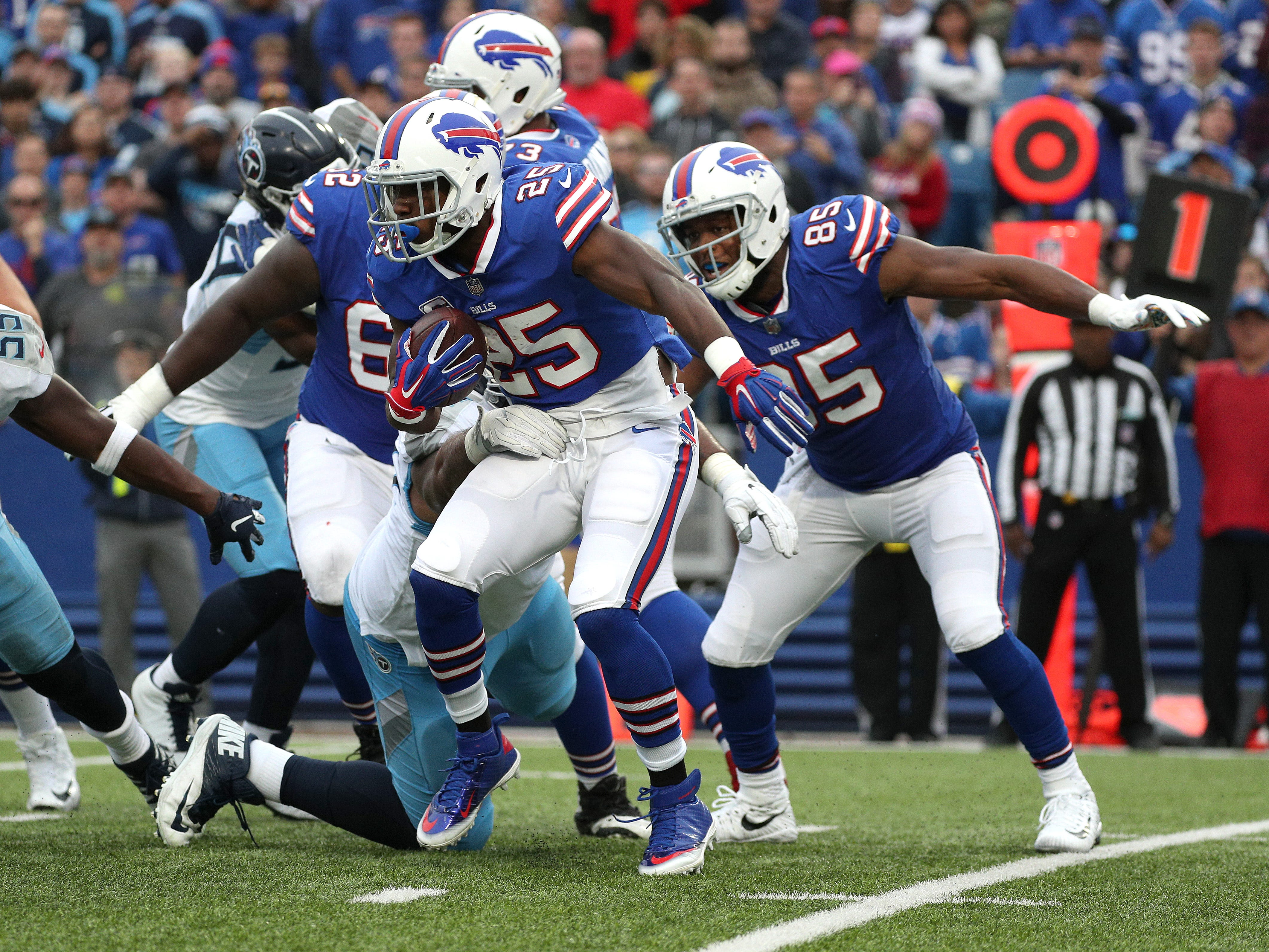 Bills running back LeSen McCoy looks for a hole along the line of scrimmage.