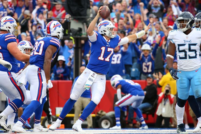 Oct 7, 2018; Orchard Park, NY, USA; Buffalo Bills quarterback Josh Allen (17) celebrates after making a touchdown run against the Tennessee Titans during the first quarter at New Era Field. Mandatory Credit: Rich Barnes-USA TODAY Sports