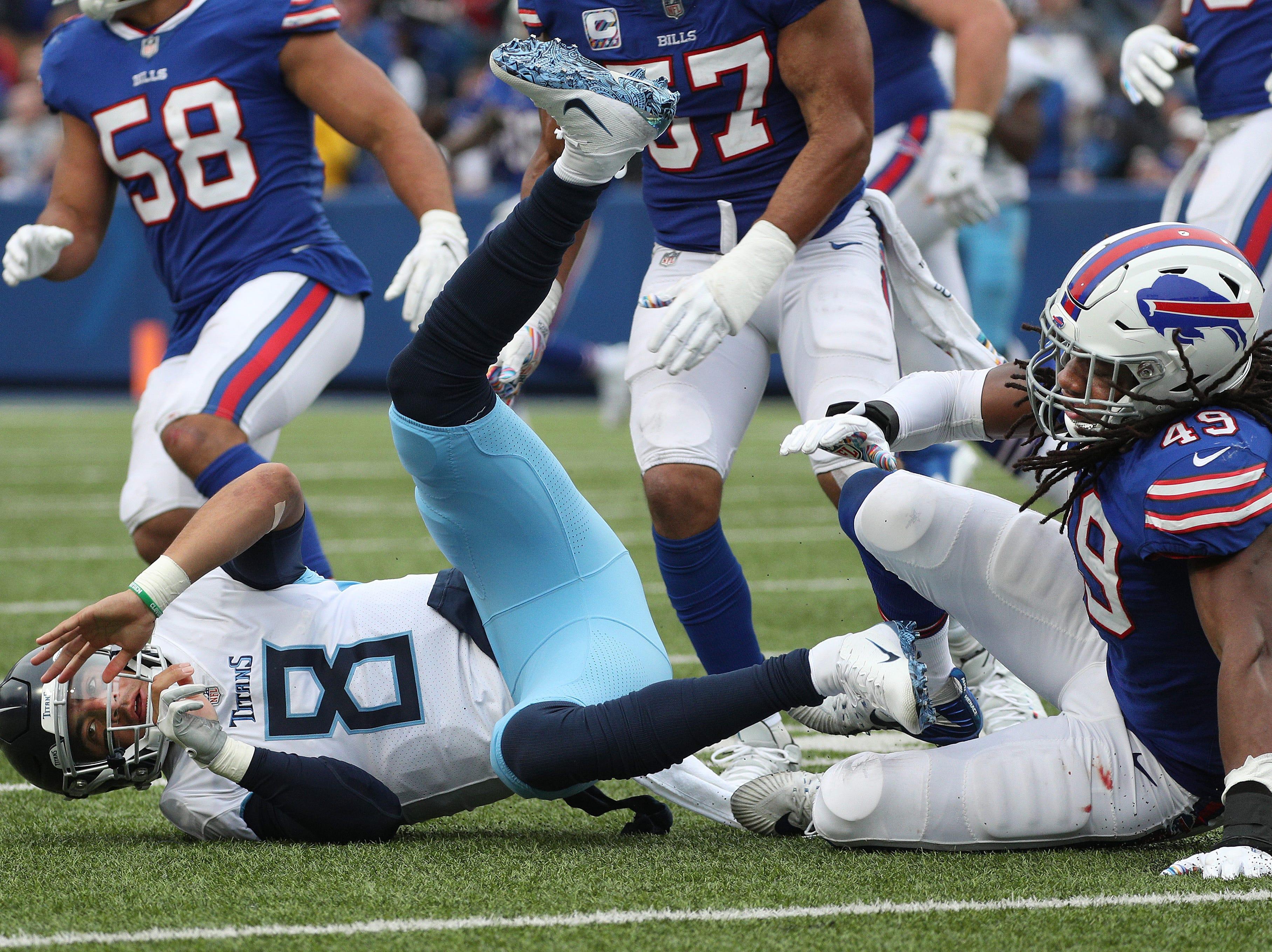 Bills Tremaine Edmunds pressures Titans quarterback Marcus Mariota.