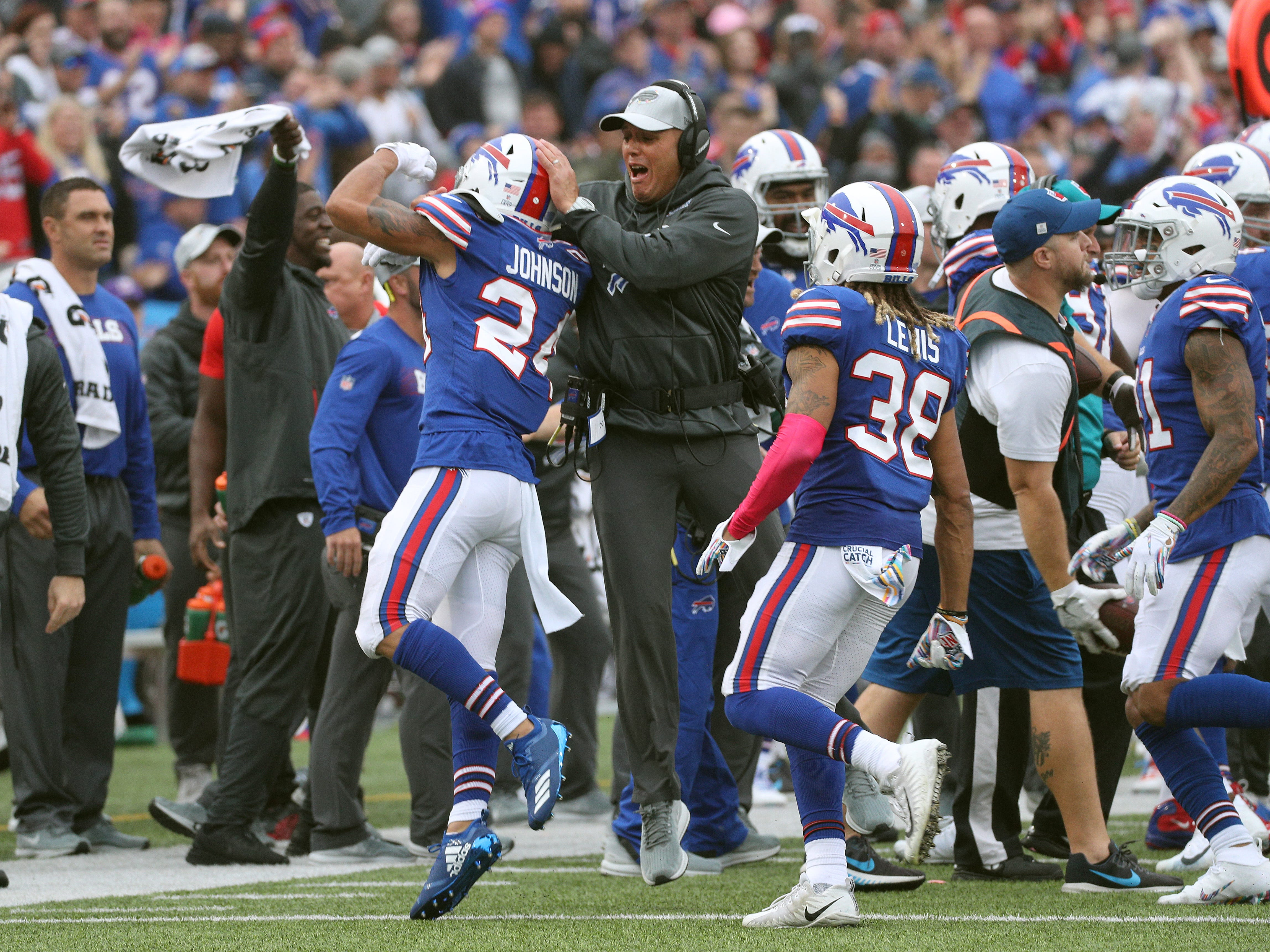 The Bills bench celebrates after Taron Johnson intercepted a pass.