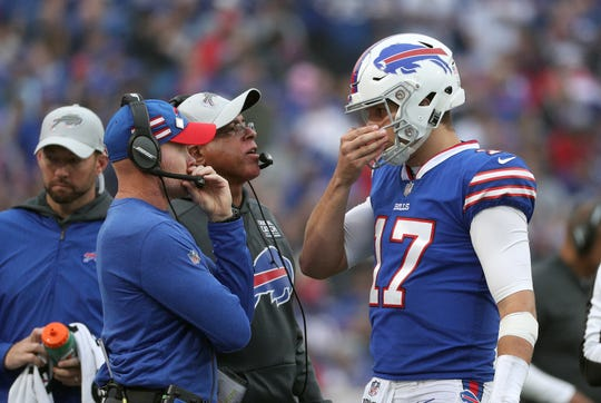Bills head coach Sean McDermott meets with his quarterback Josh Allen during a timeout against the Titans.