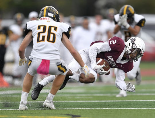 Aquinas' Kobe McNair, right, makes a catch in front of McQuaid's Casey Howlett during a regular season game played at Aquinas Institute, Saturday, Oct. 6, 2018. Aquinas beat McQuaid 22-19.