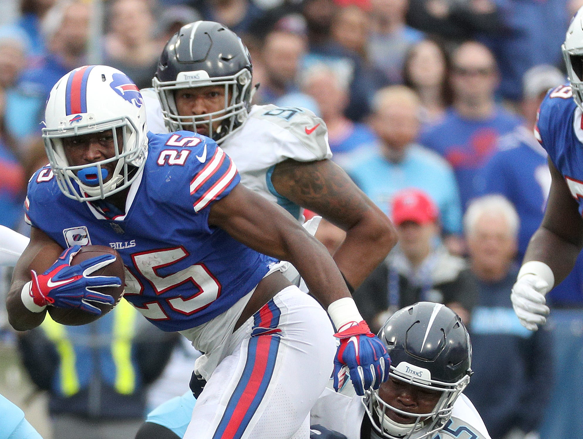 Bills running back LeSean McCoy is tackled from behind by Titans Jayon Brown.