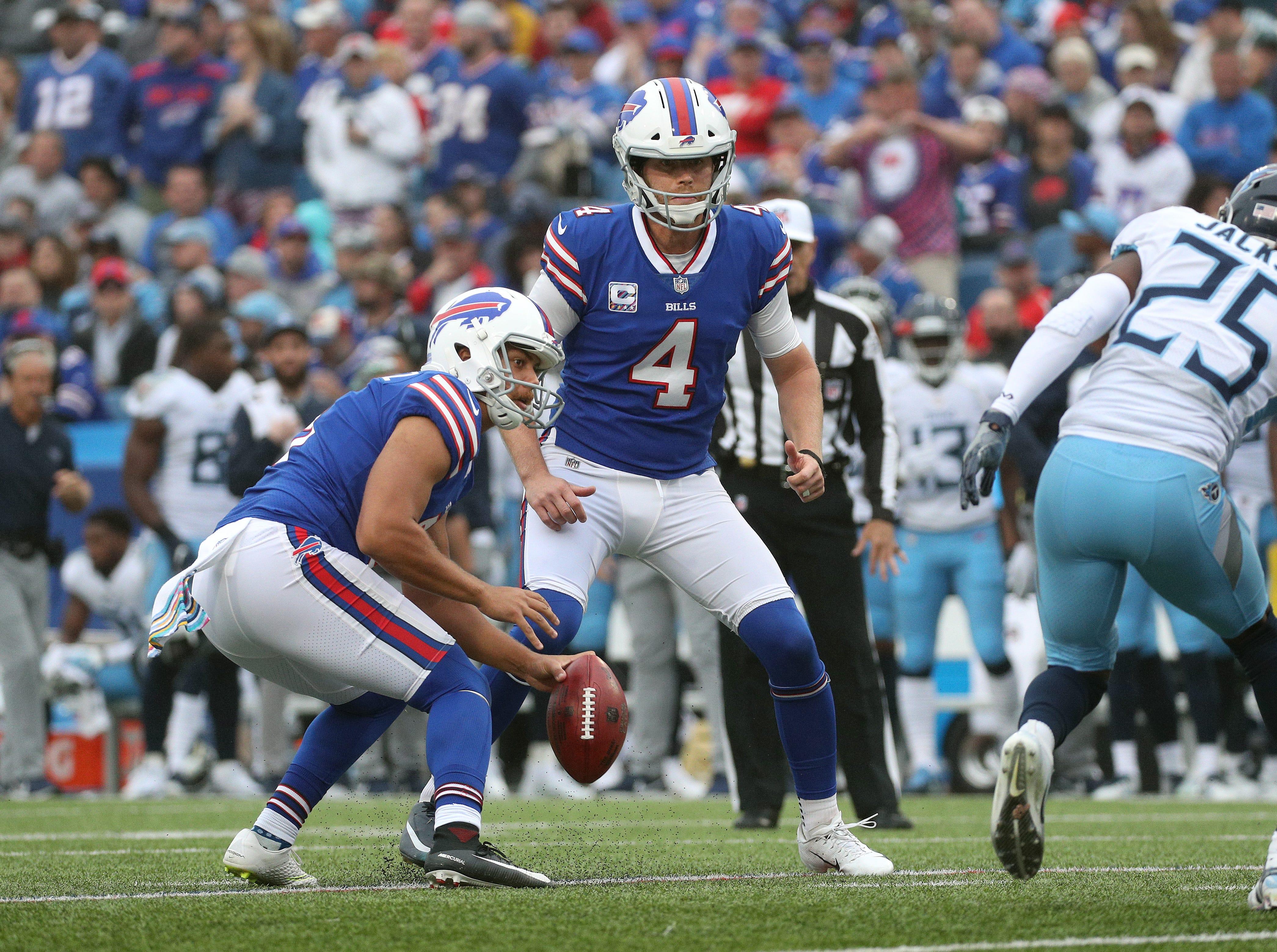 Bills holder Corey Bojorquez pulls back the ball on a botched field goal attempt.