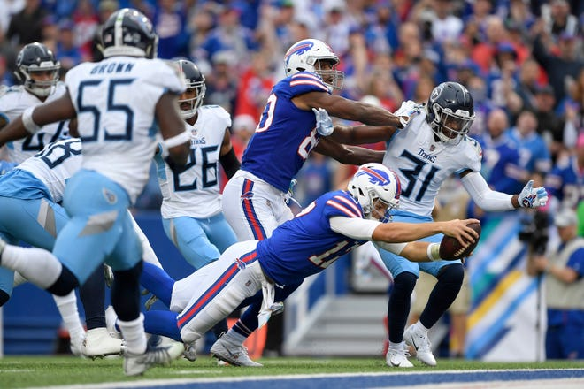 Buffalo Bills quarterback Josh Allen (17) dives in for a touchdown run against the Tennessee Titans during the first half of an NFL football game, Sunday, Oct. 7, 2018, in Orchard Park, N.Y. (AP Photo/Adrian Kraus)