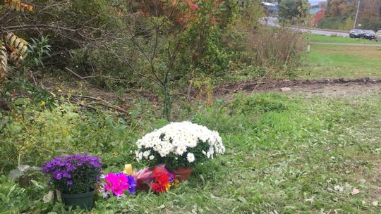A makeshift memorial at the site of Saturday's fatal limo crash near Schenectady.