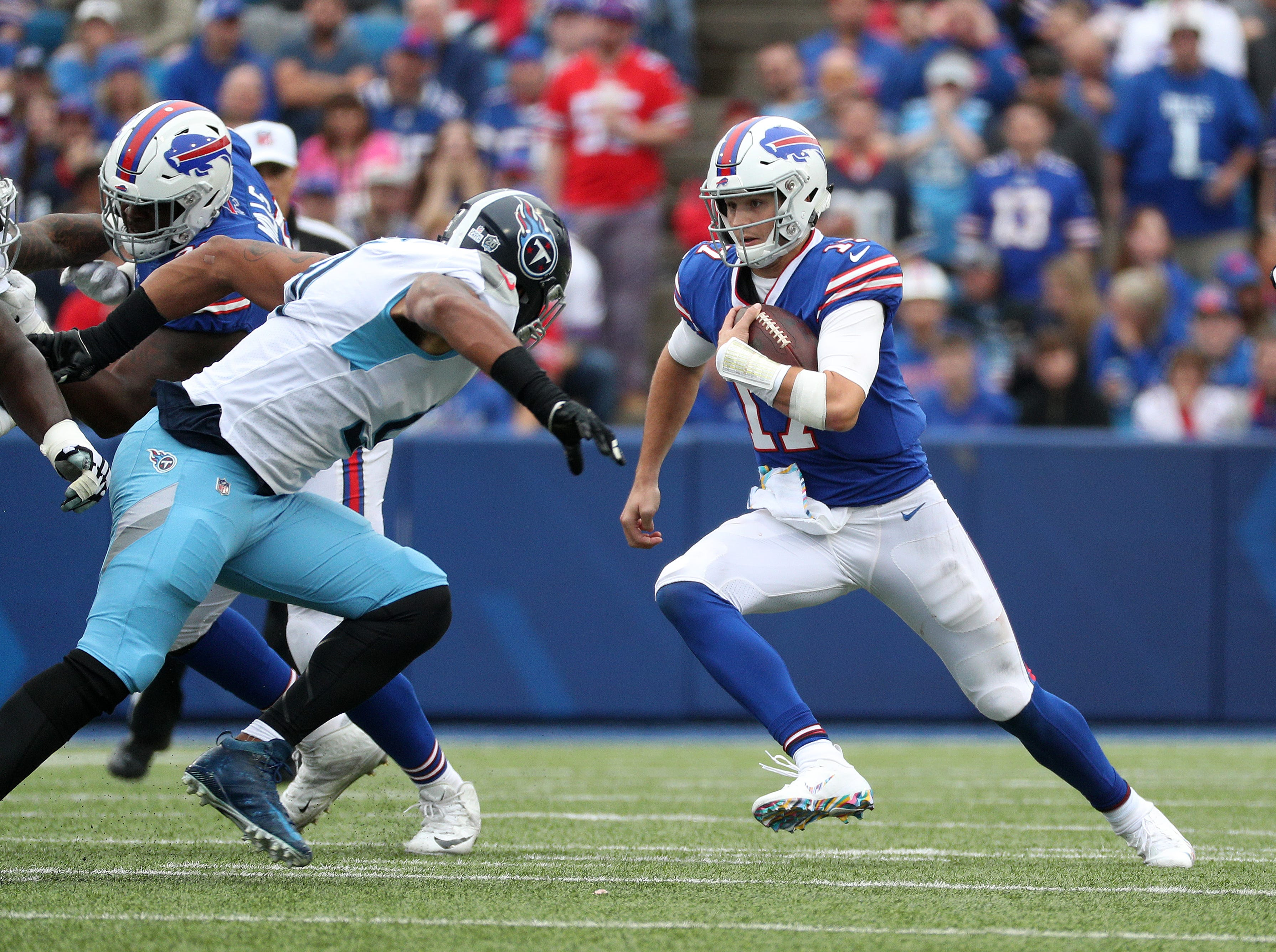Bills quarterback Josh Allen tucks the ball and runs for a short gain.