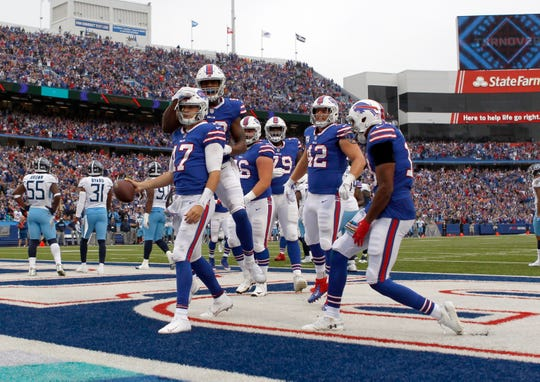 Oct 7, 2018; Orchard Park, NY, USA; Buffalo Bills quarterback Josh Allen (17) celebrates with teammates after scoring a touchdown against the Tennessee Titans during the first half at New Era Field. Mandatory Credit: Timothy T. Ludwig-USA TODAY Sports