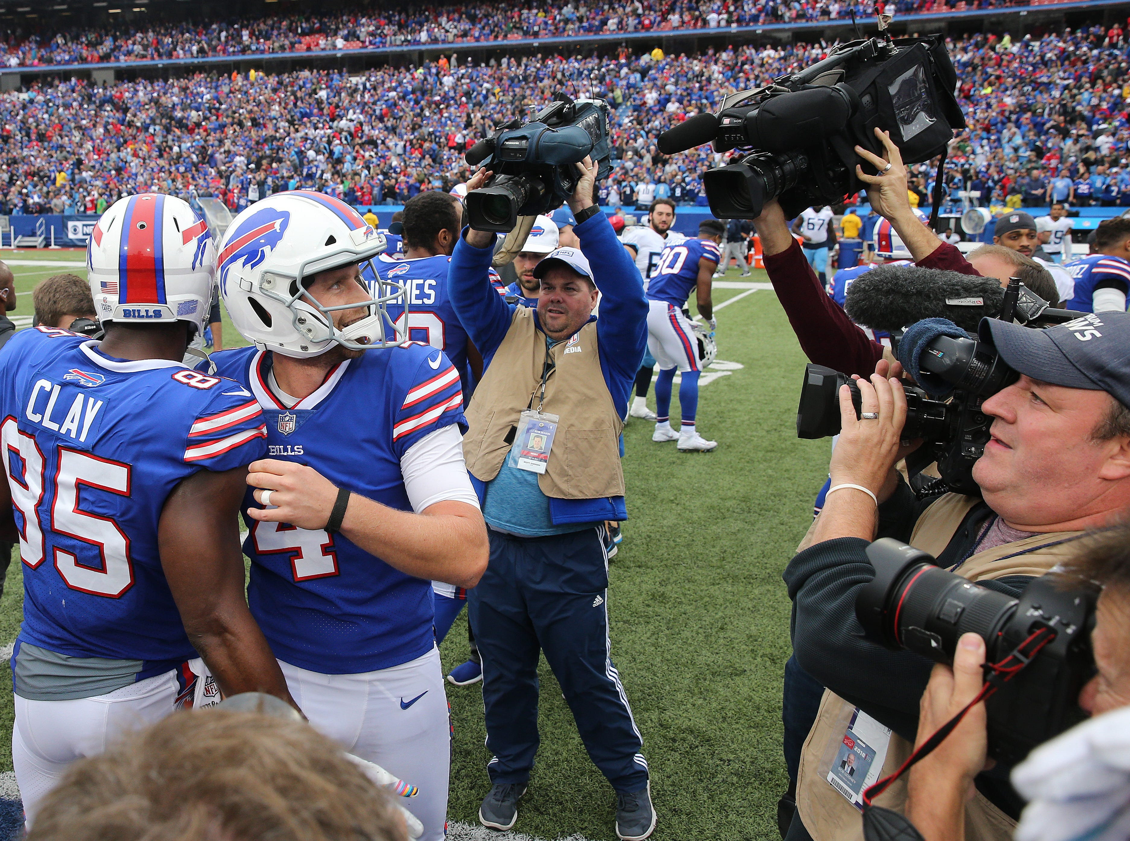 Bills kicker Stephen Hauschka is congratulated after kicking a 46-yard field goal o the last play of the game to be the Titans 13-12.
