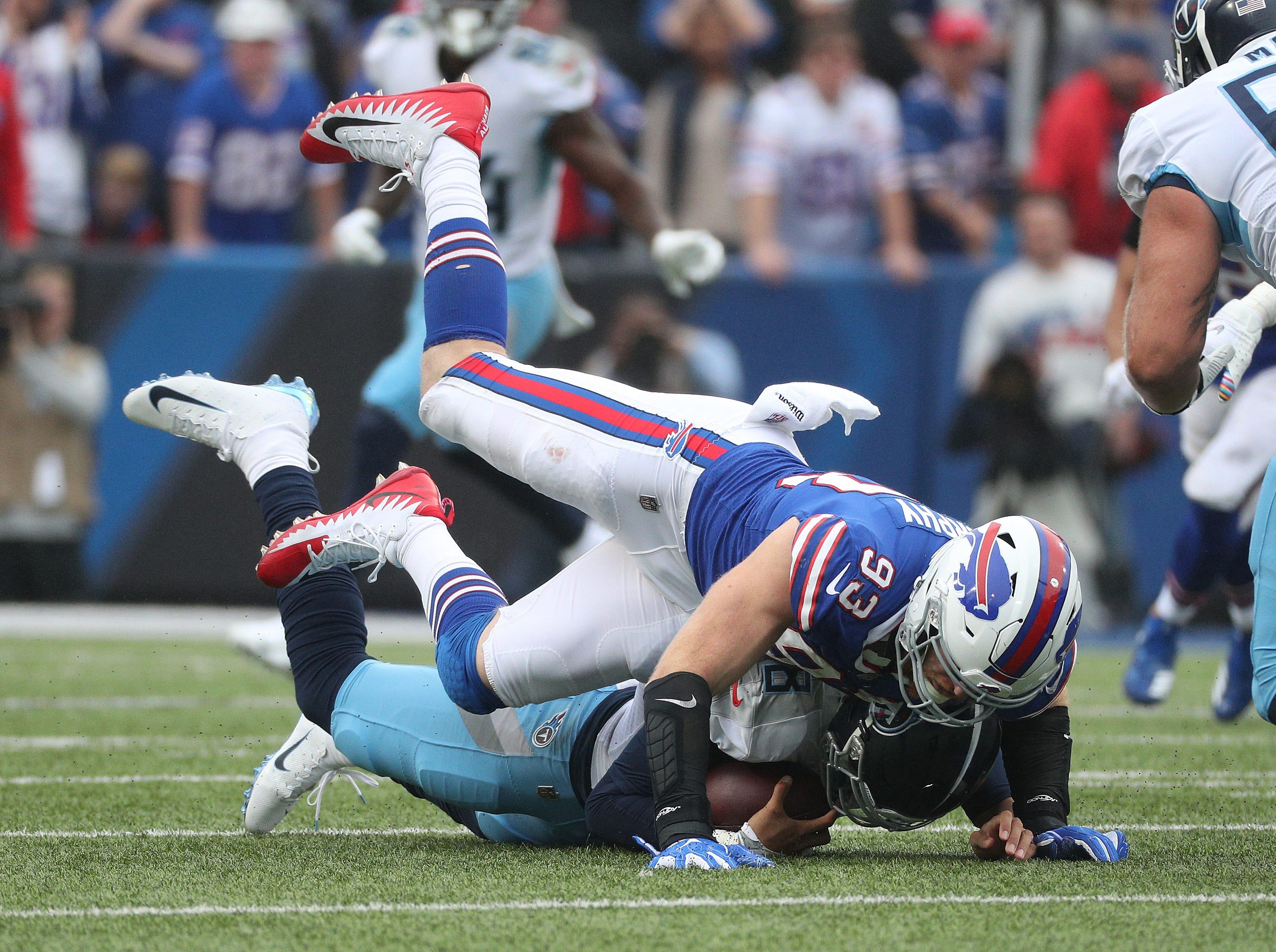 Bills Trent Murphy sacks Titans quarterback Marcus Mariota.