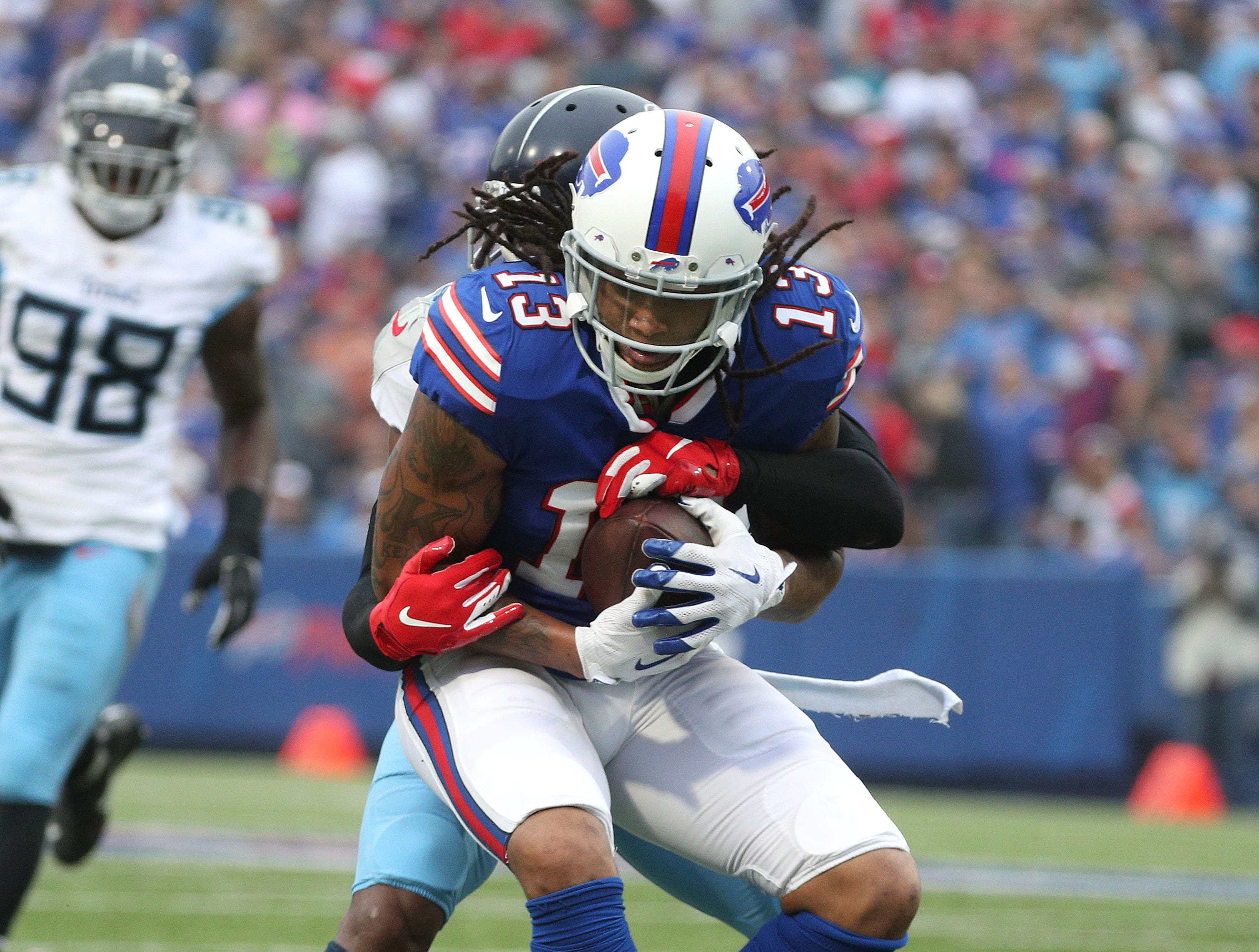 Bills receiver Kelvin Benjamin is wrapped up after a catch.