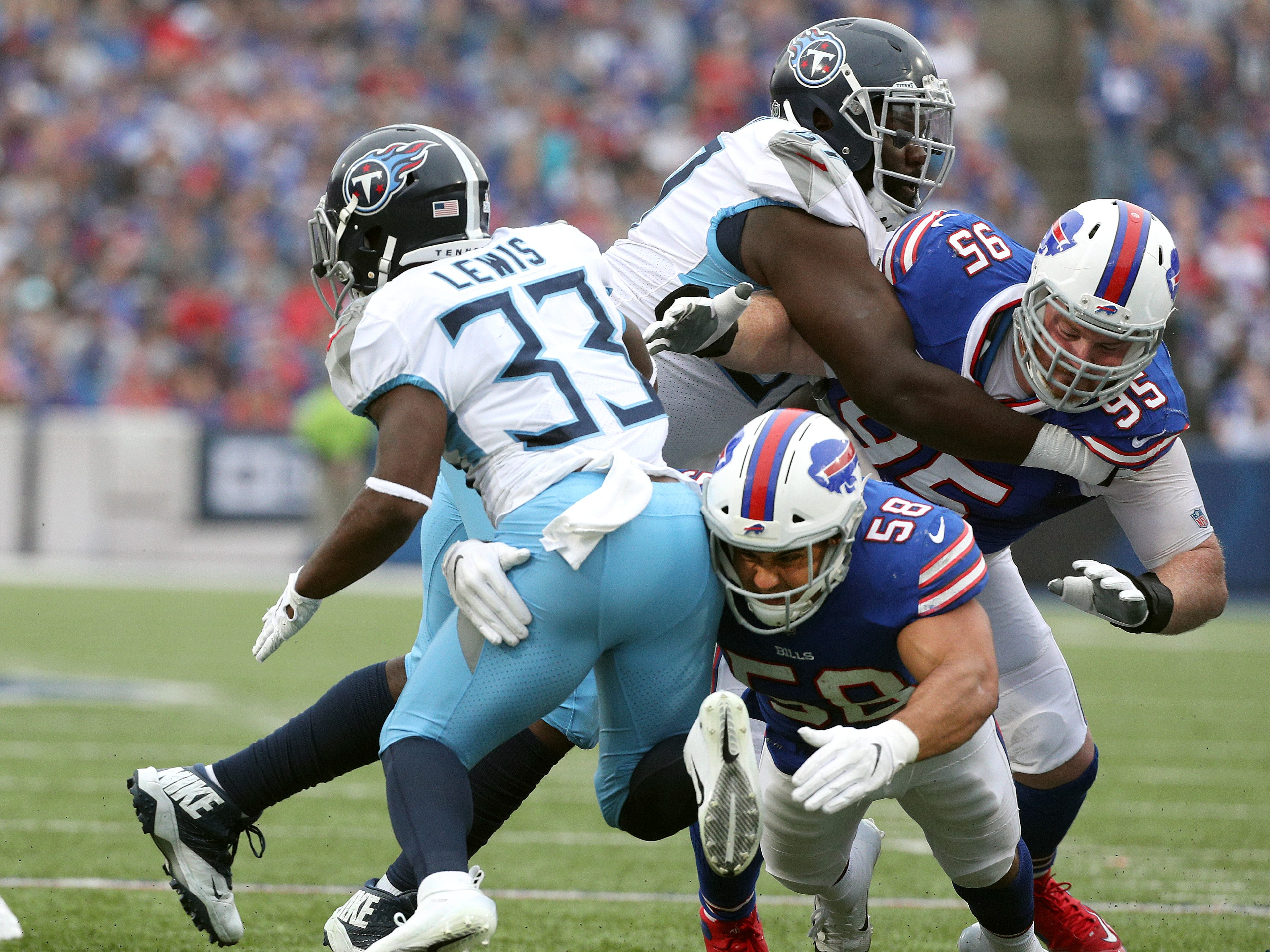 The Bills defense came up strong  against Tennessee as Matt Milano and Kyle Willams tackle Dion Lewis.