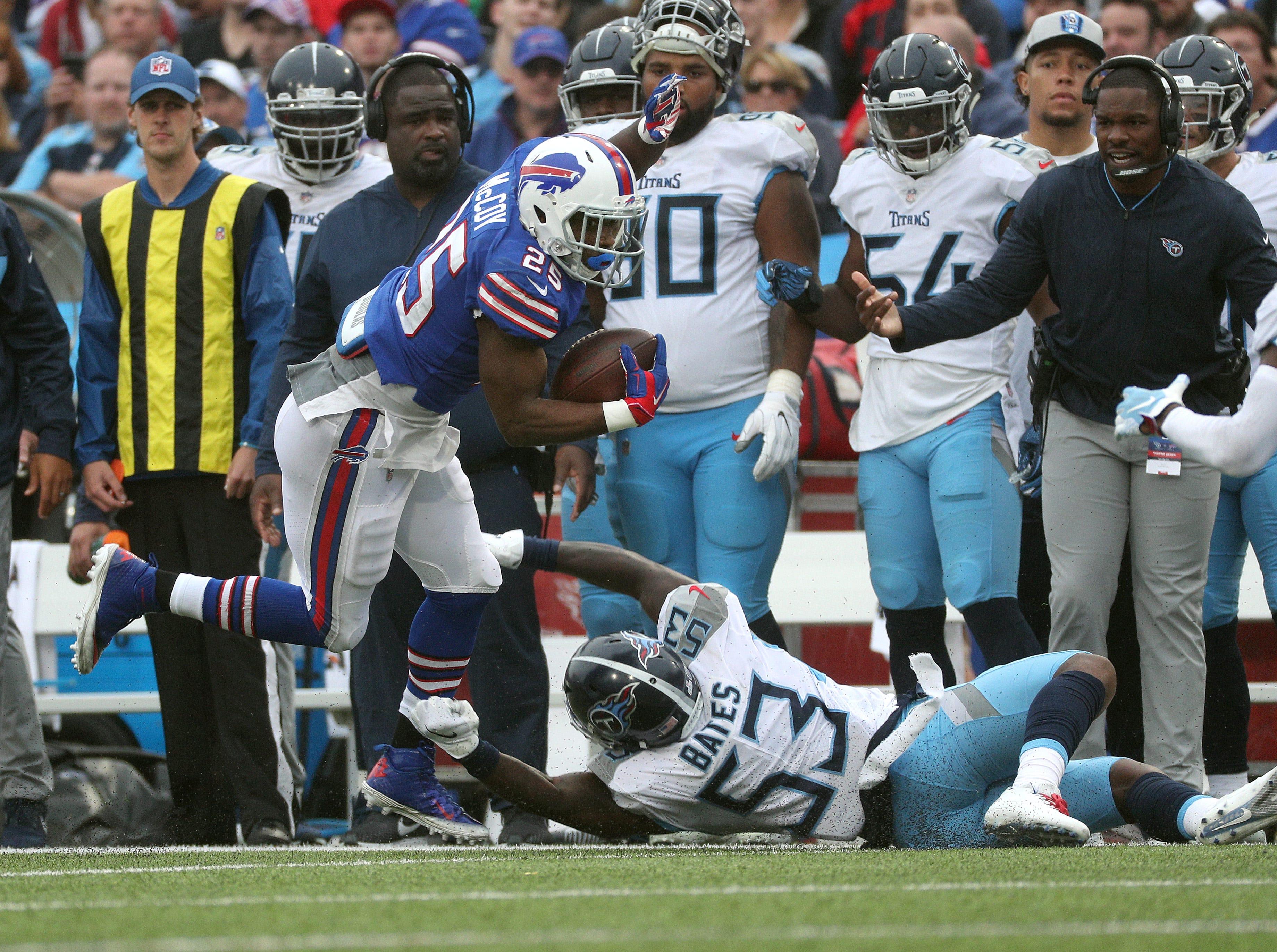 Bills running back LeSean McCoy slips a tackle by Titan's Daren Bates.