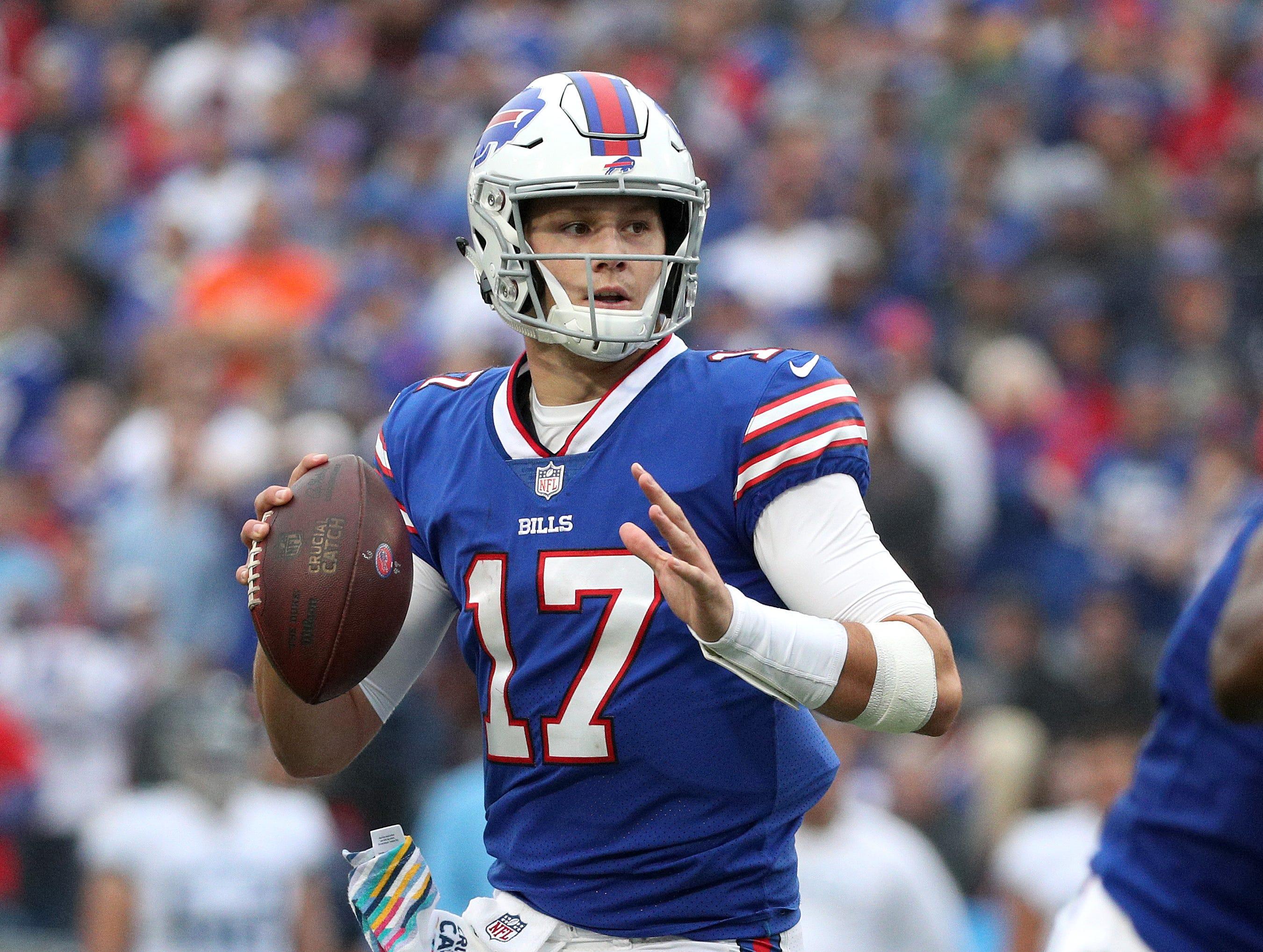 Bills quarterback Josh Allen looks downfield.