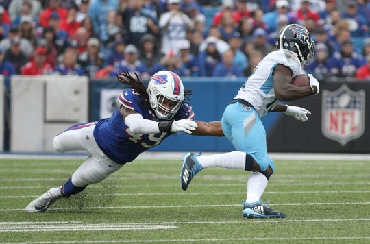 Bills linebacker Tremaine Edmunds looks to tackle Titans receiver Tywan Taylor.
