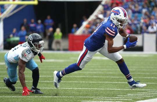 Bills receiver Zay Jones looks for yards after a catch.