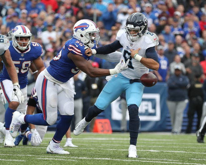 Bills Jerry Hughes strips the ball from Titan's quarterback Marcus Mariota.  The Titans retained possession after the ball went out of bounds.