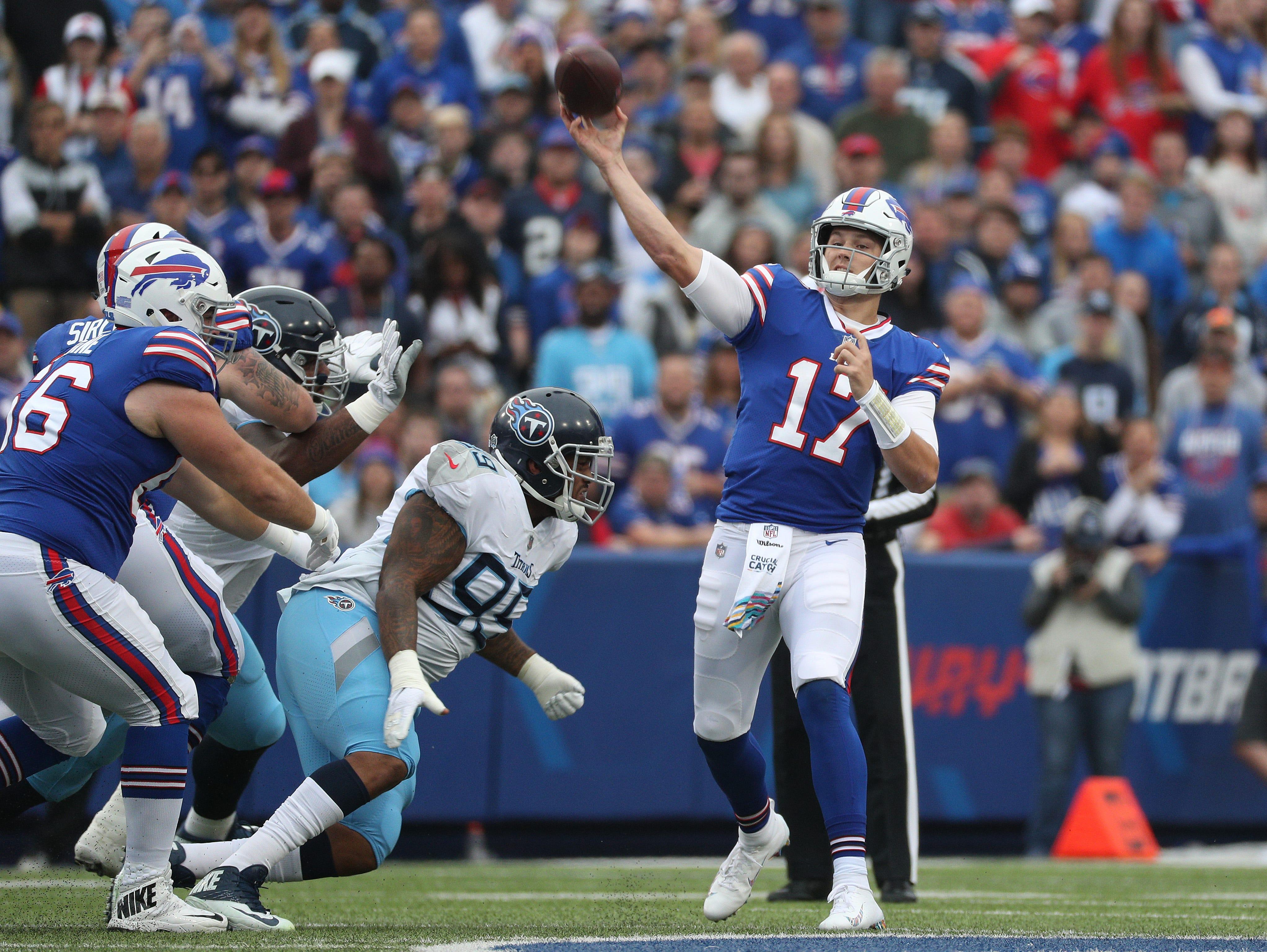 Bills quarterback Josh Allen steps into this deep pass.