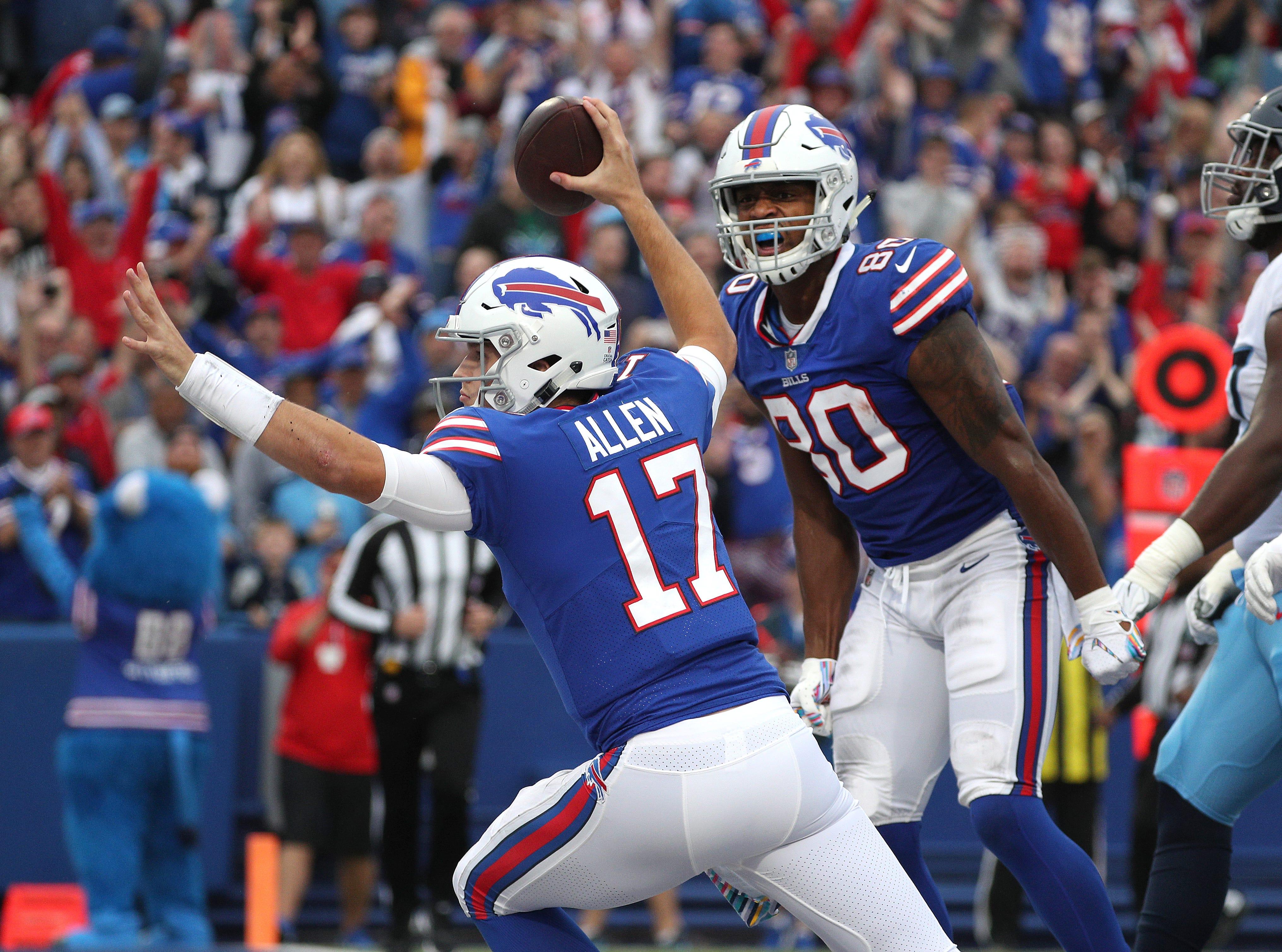 Bills quarterback Josh Allen celebrates his first quarter touchdown scramble against the Titans.