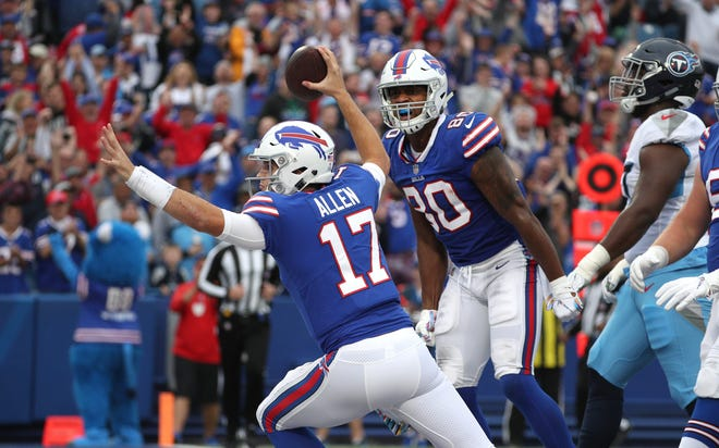 Bills quarterback Josh Allen celebrates his first quarter touchdown scramble against the Titans.
