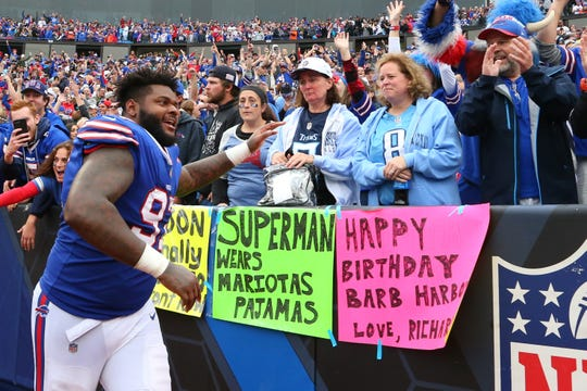 Buffalo Bills nose tackle Jordan Phillips (97) celebrates in front of Tennessee Titans fans following a game at New Era Field on Oct. 7.