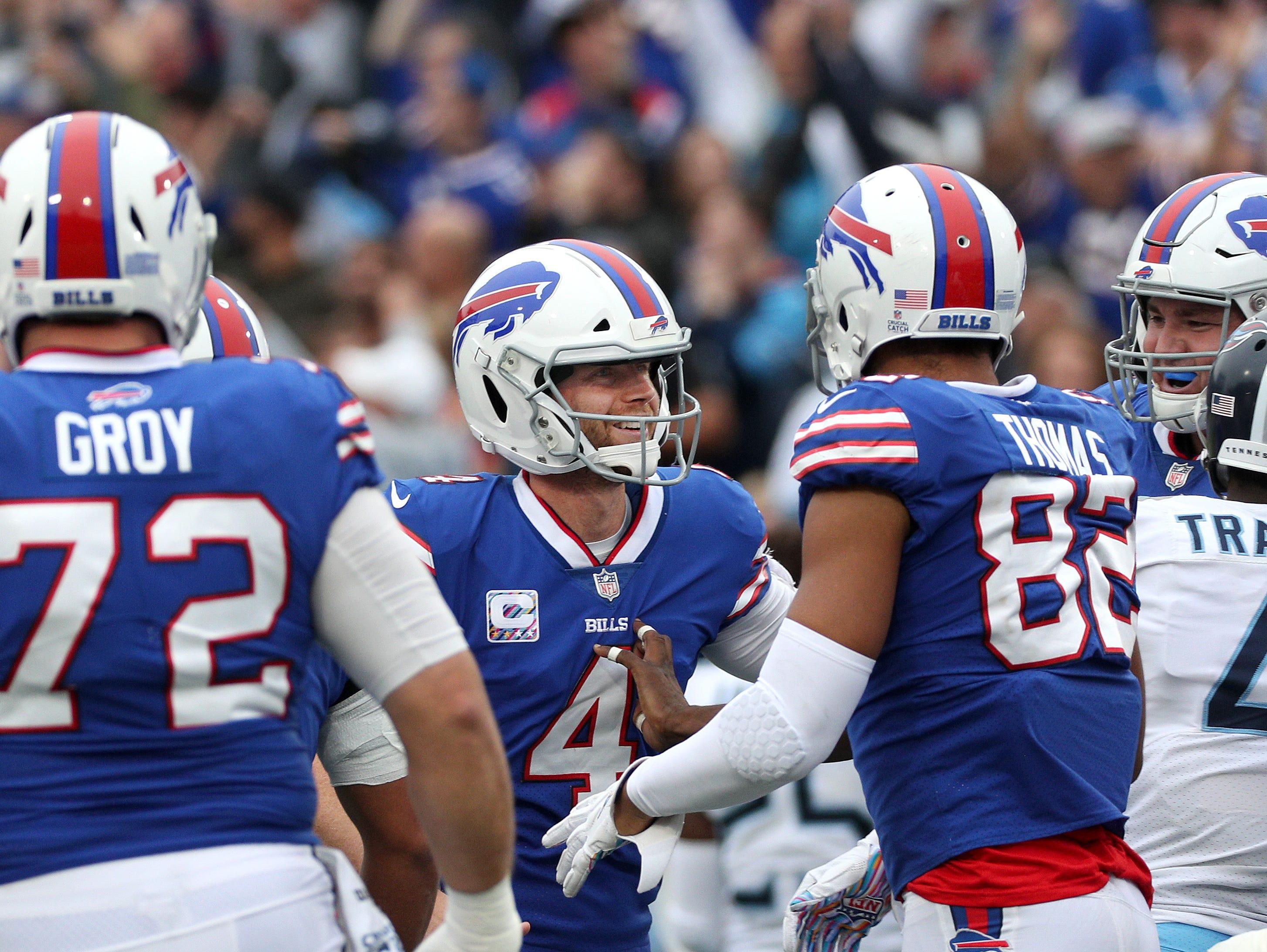 Bill kicker Stephen Hauschka celebrates his 46-yard game winning field goal to beat the Titans 13-12.