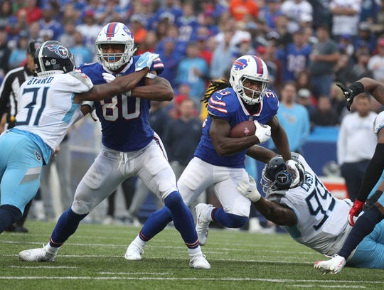 Bills running back Chris Ivory finds a hole at the line of scrimmage.