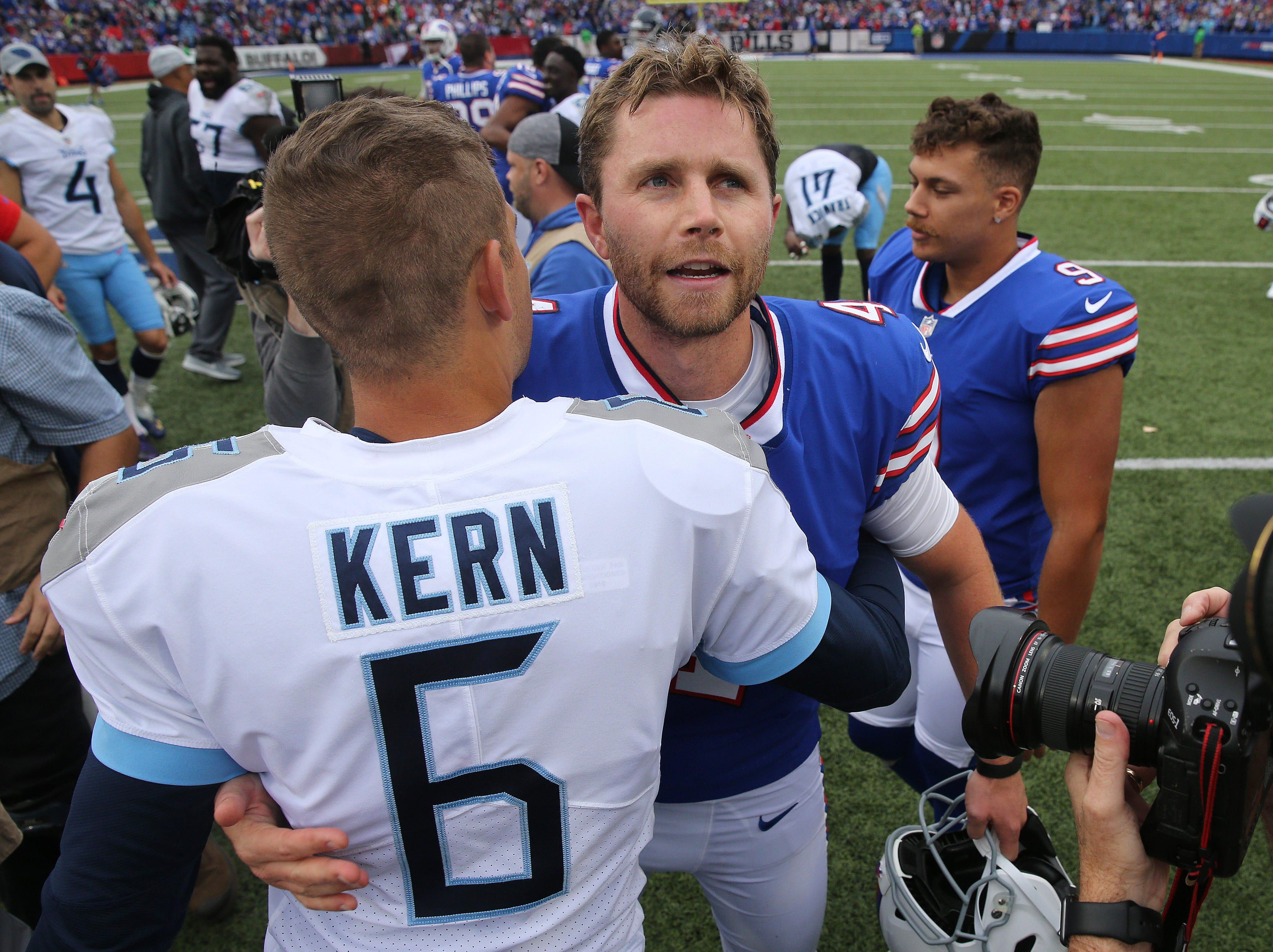 Bills kicker Stephen Hauschka meets with Titans punter Brett Kern after Hauschka's late field goal won the game 13-12.