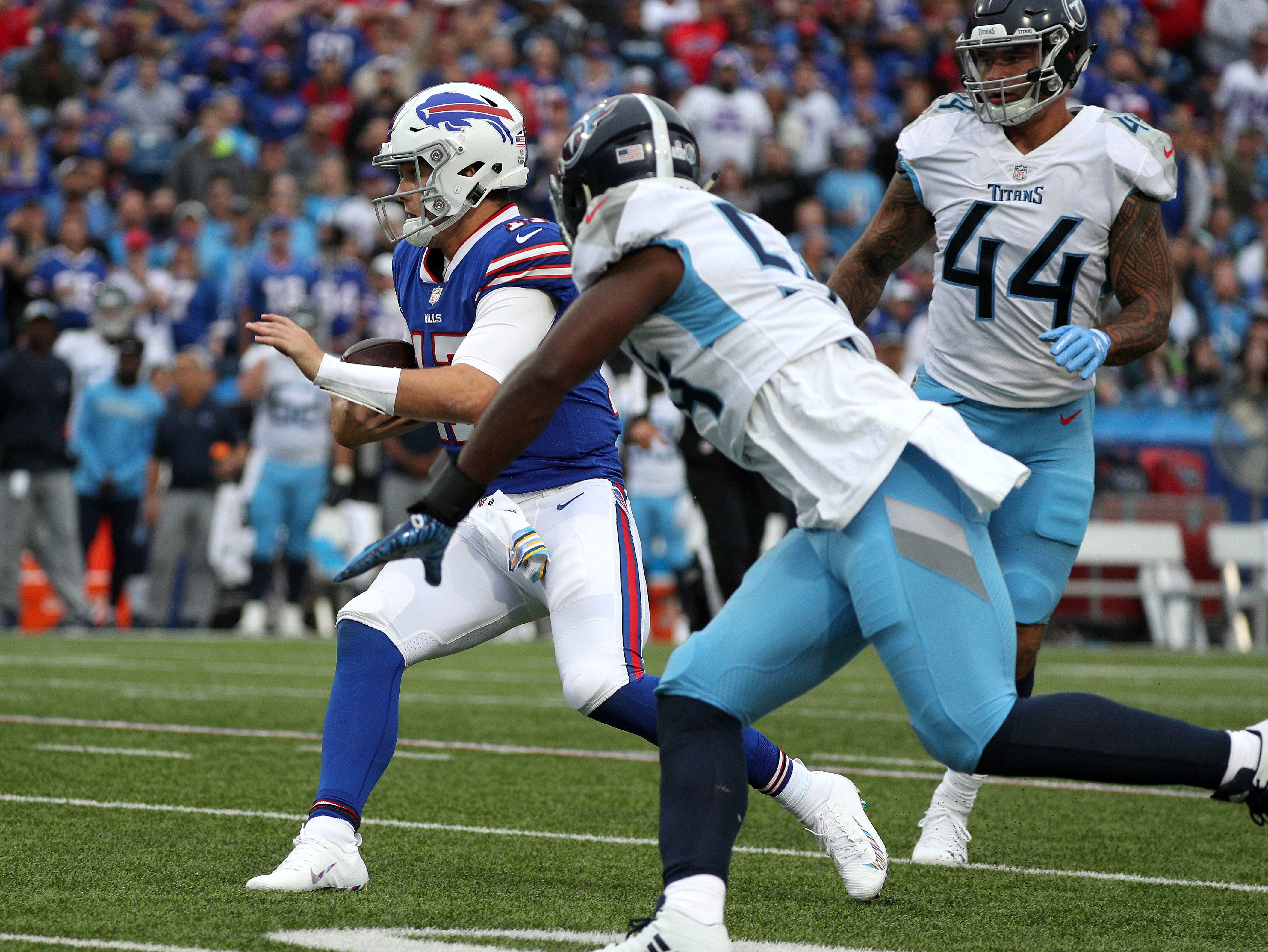 Bills uaterback Josh Allen scrambles for first quarter touchdown against the Titans.