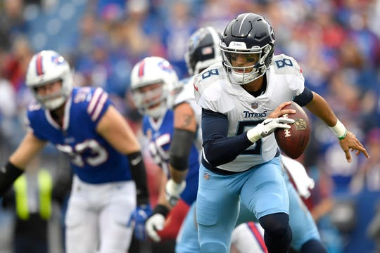 Tennessee Titans quarterback Marcus Mariota scrambles against the Buffalo Bills during the first half of an NFL football game, Sunday, Oct. 7, 2018, in Orchard Park, N.Y. (AP Photo/Adrian Kraus)