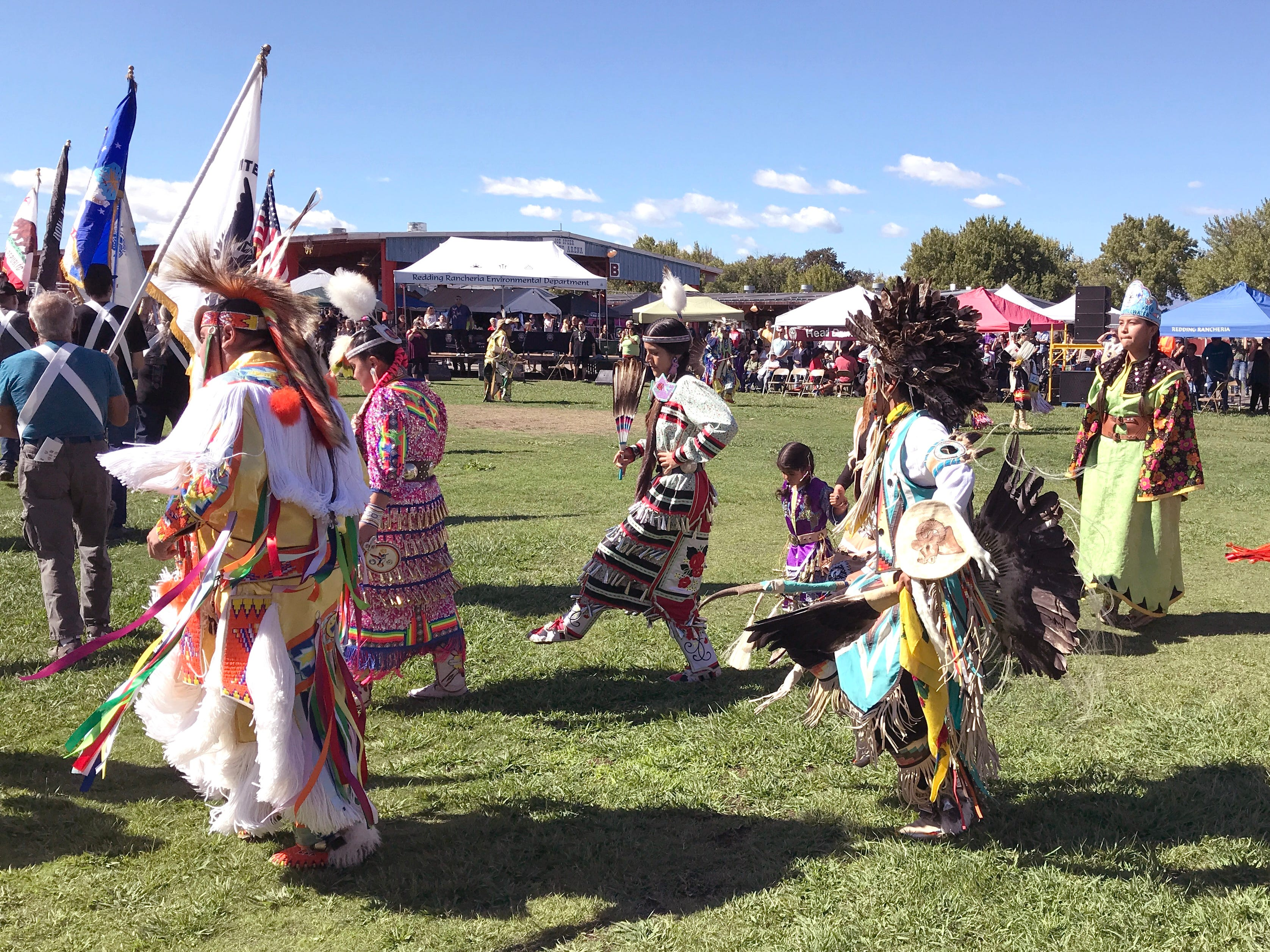 A procession of dancers during Saturday afternoon's grand entry at the Stillwater Powwow.