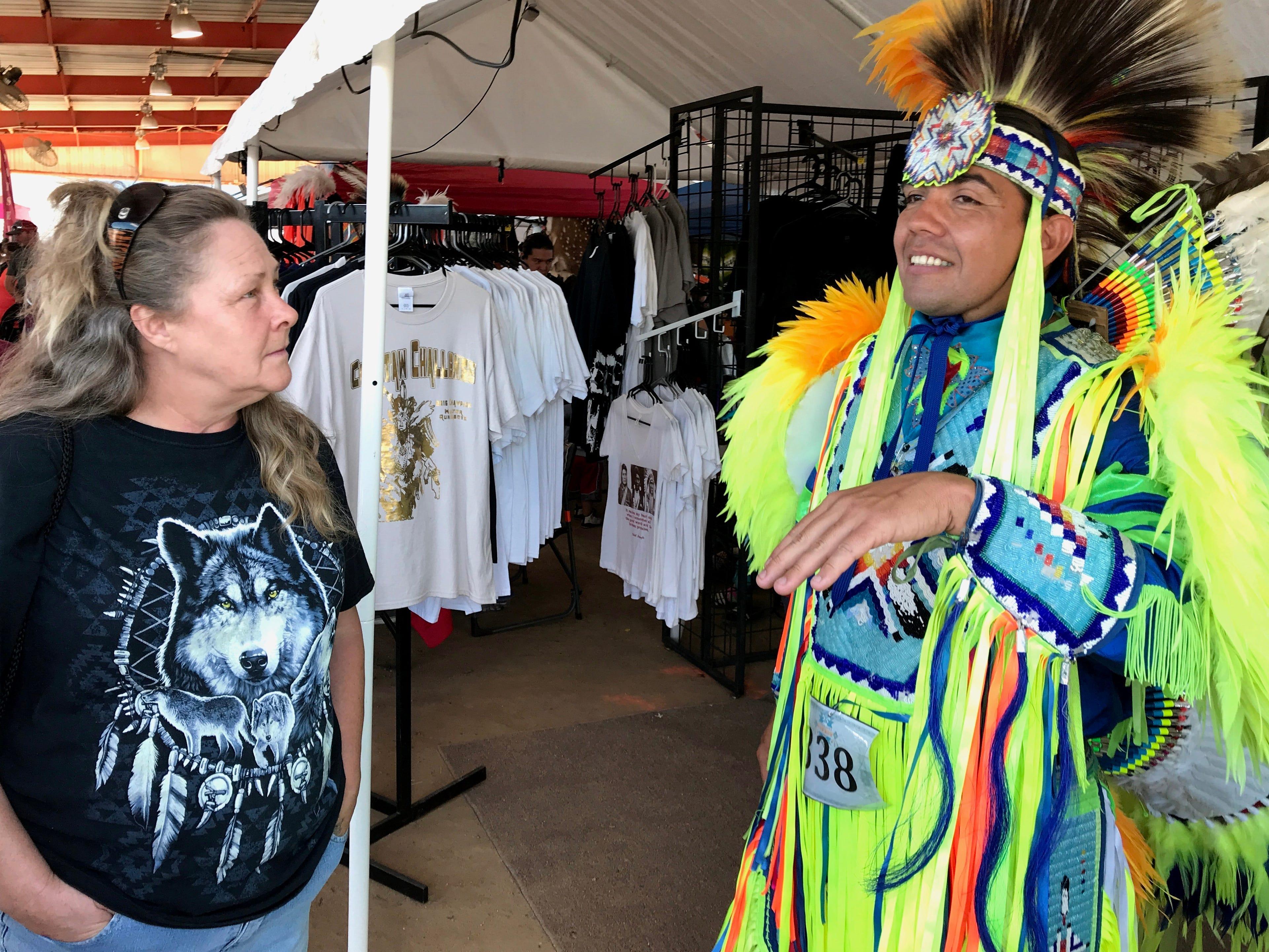 Lisa Davis of Anderson, left, talks with Winnemem-Wintu dancer Douglas Scholfield of Redding on Saturday at the 2018 Stillwater Powwow in Anderson.