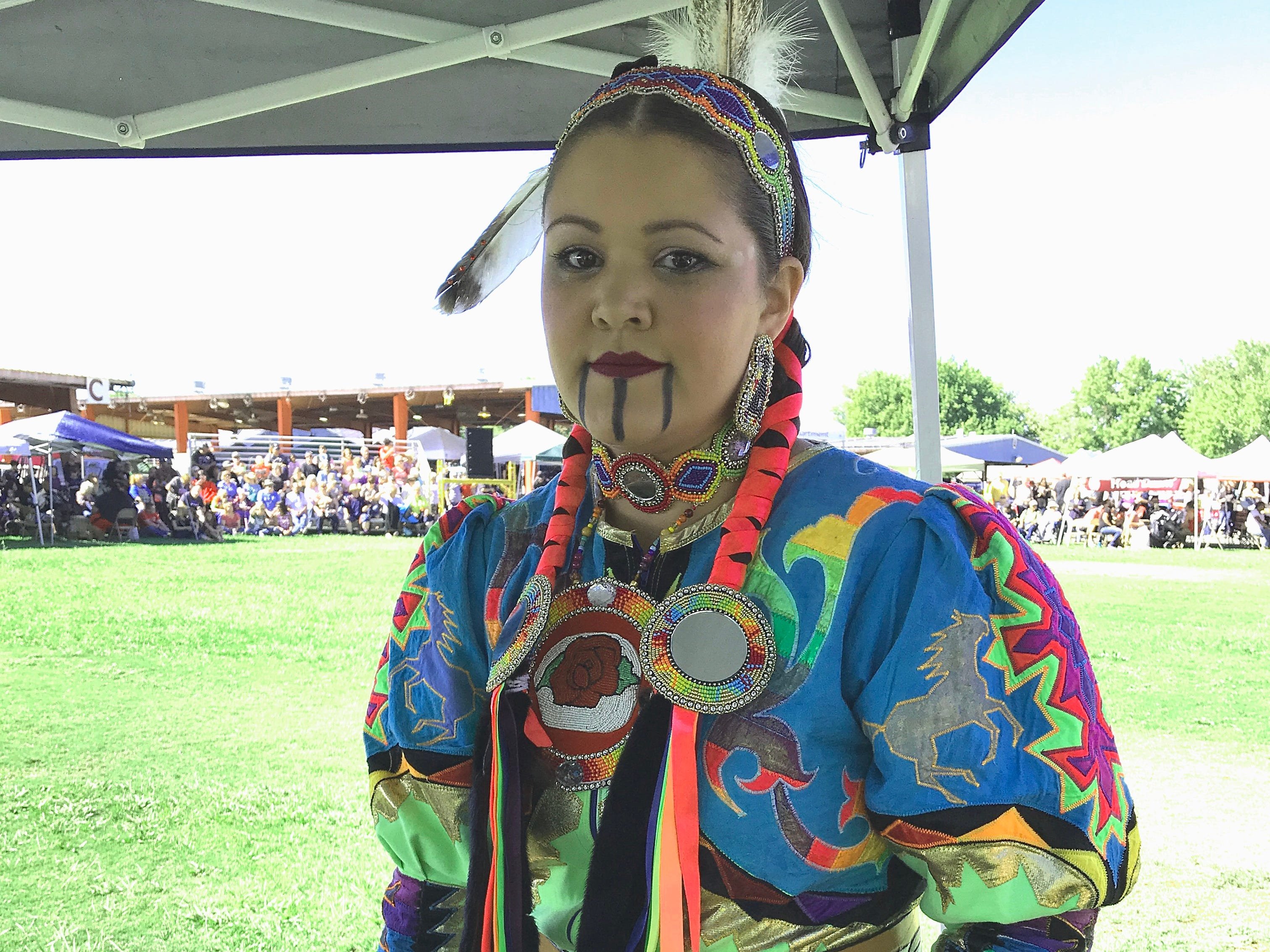 Vanessa Scholfield from Chico, of Wintu, Pit River and Wailacki heritage, prepares for Saturday's grand entry at the 2018 Stillwater Powwow at the Shasta District Fair grounds in Anderson.