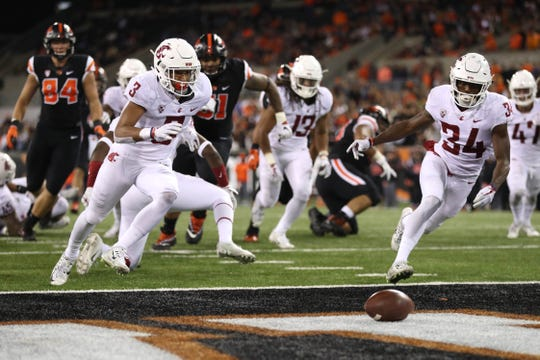 Oct 6, 2018; Corvallis, OR, USA;  Washington State Cougars cornerback Darrien Molton (3) and Washington State Cougars safety Jalen Thompson (34) runs after as loose ball fumbled by Oregon State Beavers running back Jermar Jefferson (22) for a touchback in the second half at Reser Stadium. Mandatory Credit: Jaime Valdez-USA TODAY Sports