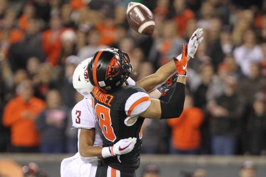Oct 6, 2018; Corvallis, OR, USA;  Oregon State Beavers wide receiver Timmy Hernandez (18) makes a catch over Washington State Cougars cornerback Darrien Molton (3) in the second half at Reser Stadium. Mandatory Credit: Jaime Valdez-USA TODAY Sports