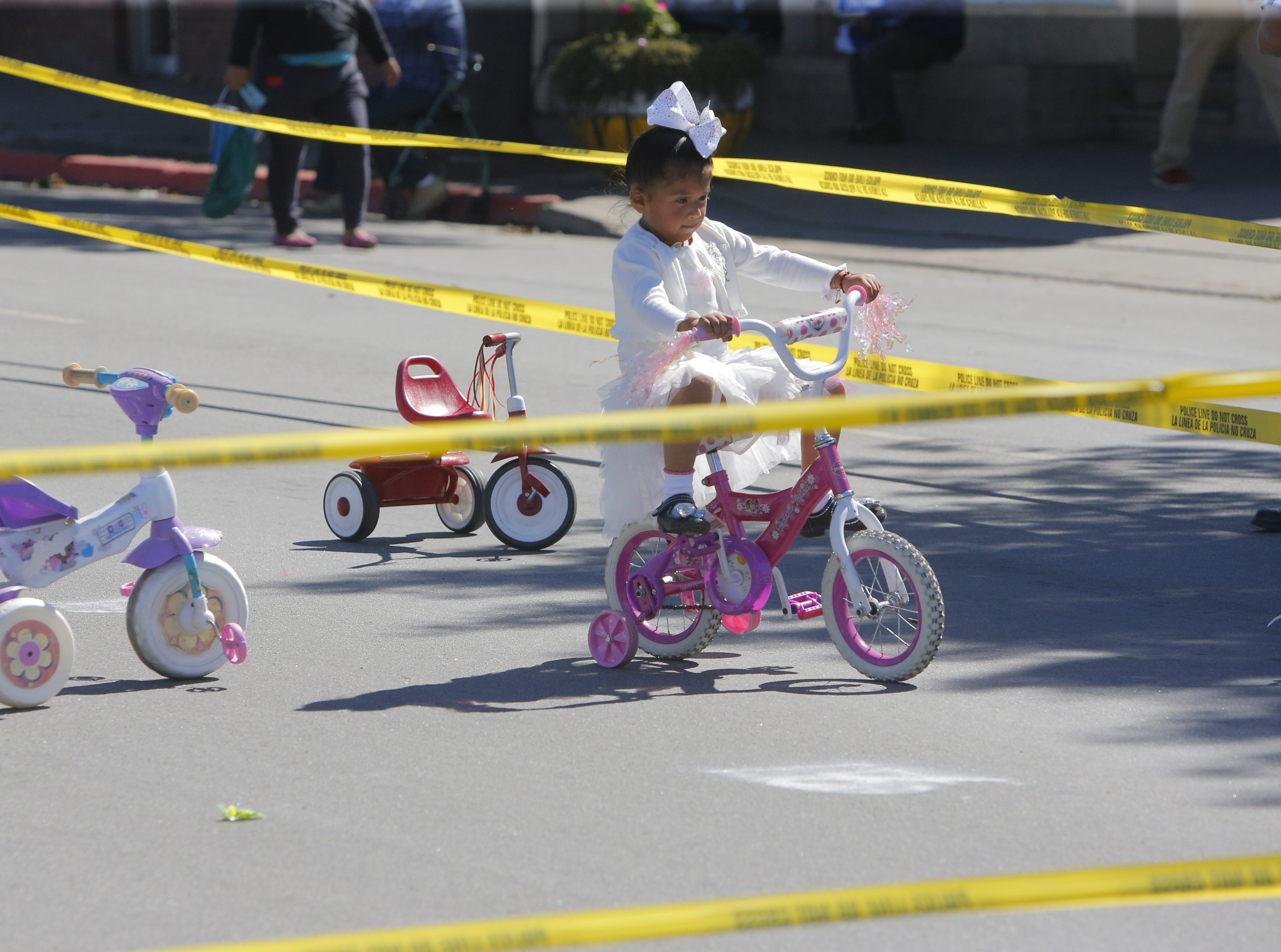 Lucia Mendoza, 5, rides a bike at 2018's Ciclovia on E. Alisal Street Sunday.