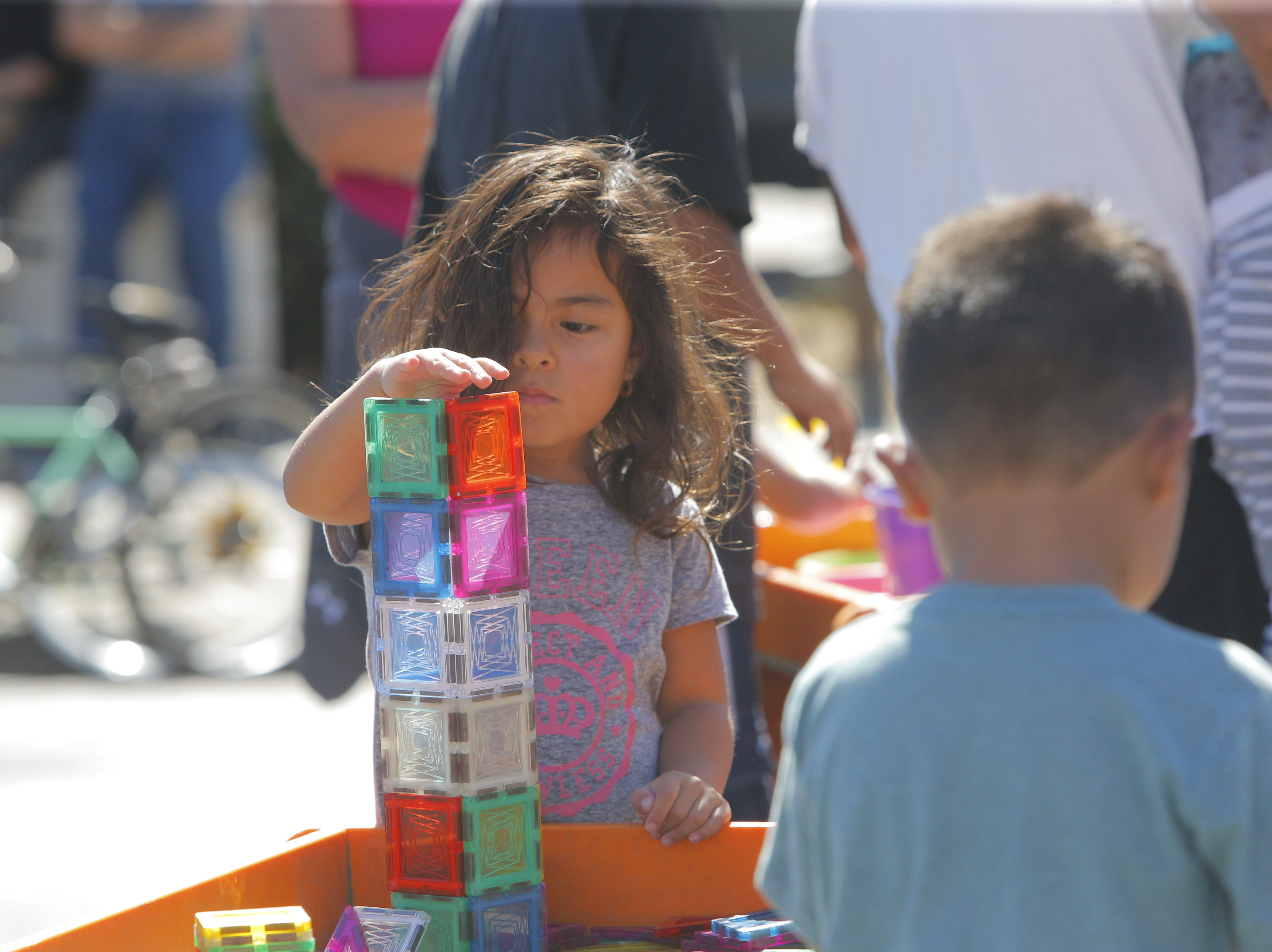 A child plays with toys at 2018's Ciclovia Salinas on E. Alisal Street Sunday.
