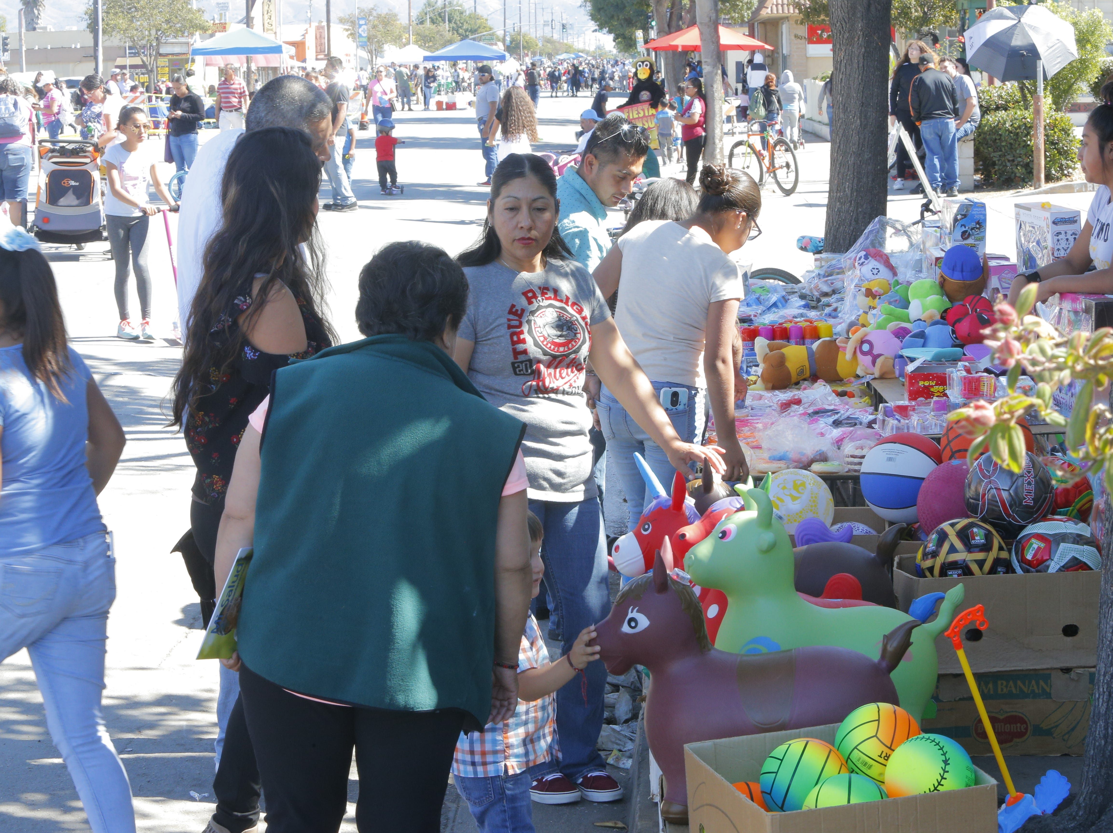 People shop for toys at 2018's Ciclovia Salinas on E. Alisal Street Sunday.