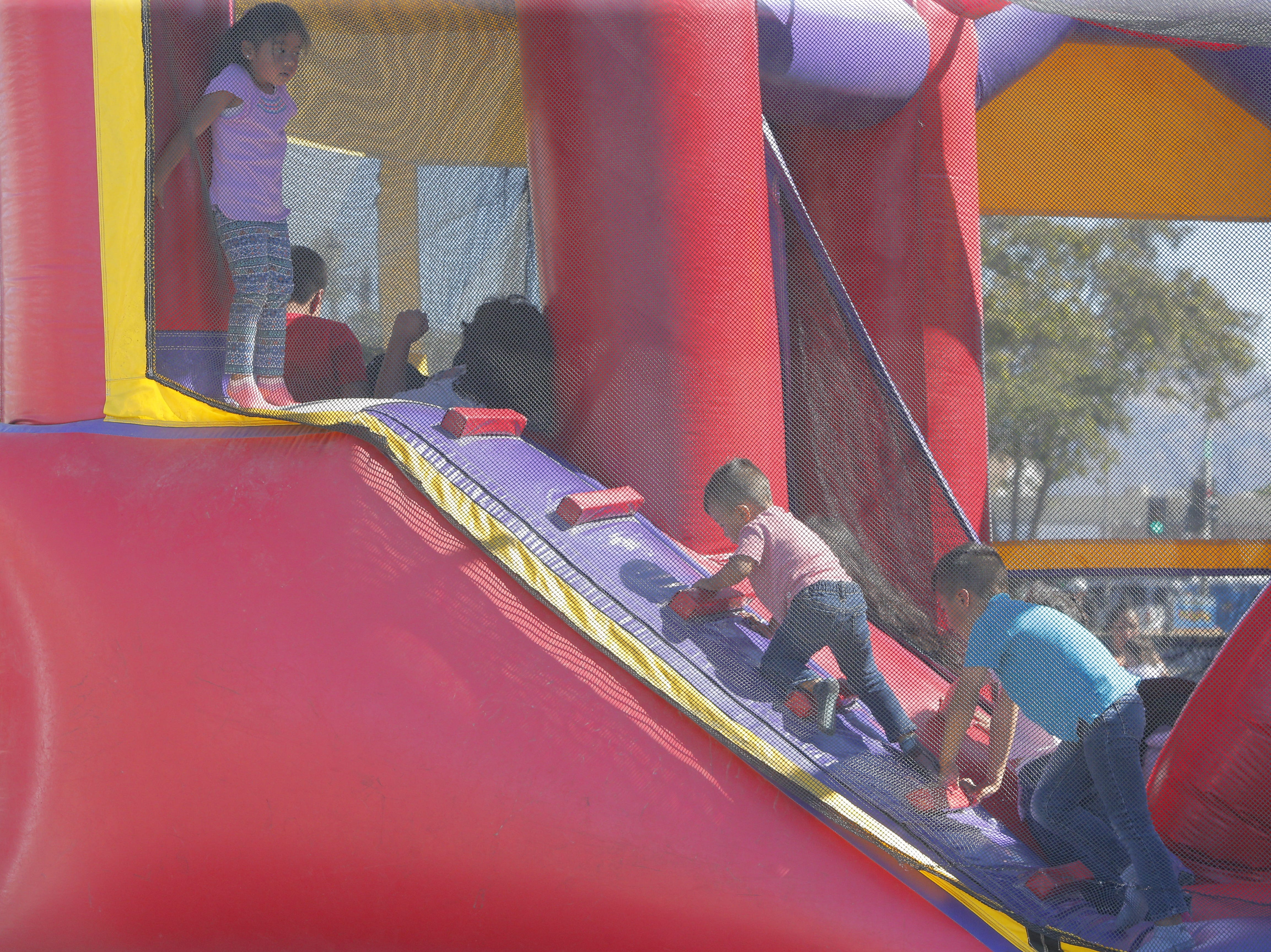 Children play at a bounce house during 2018's Ciclovia Salinas on E. Alisal Street Sunday.