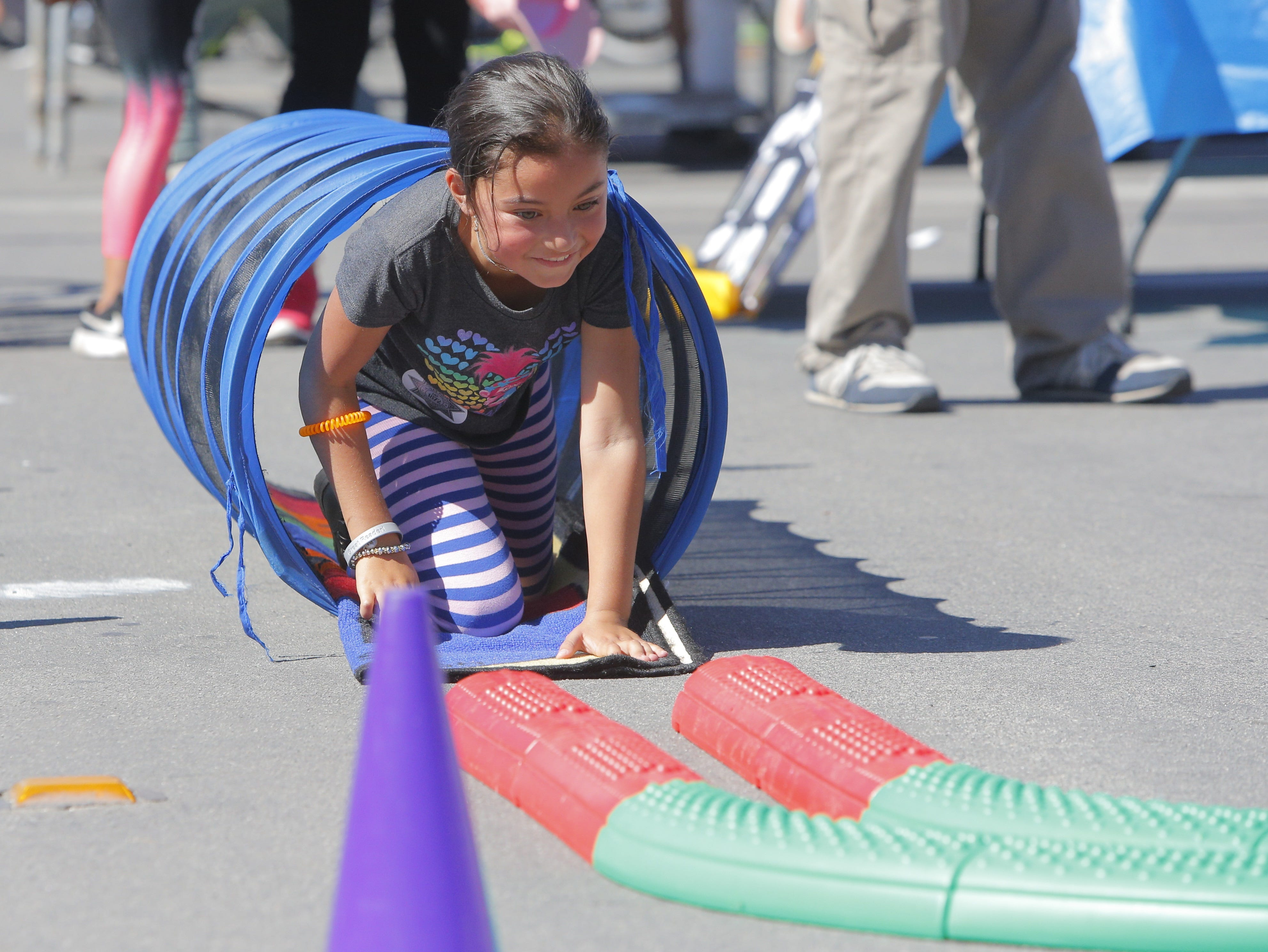 Gisselle Chavez, 8, goes through an obstacle course at 2018's Ciclovia Salinas on E. Alisal Street Sunday.