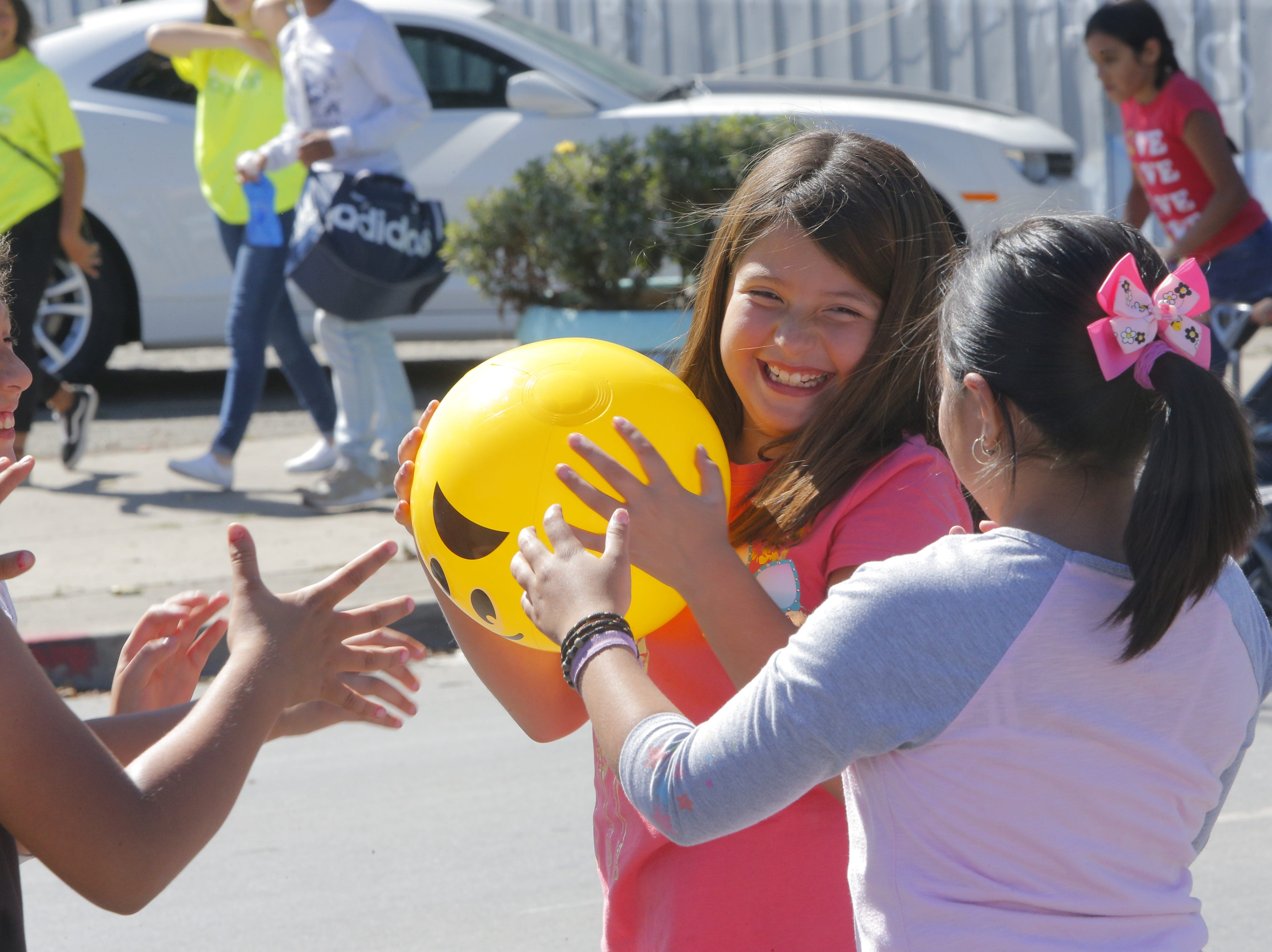 Jayleene Valencia, 9, plays a game of hot potato for candy at 2018's Ciclovia Salinas on E. Alisal Street Sunday.