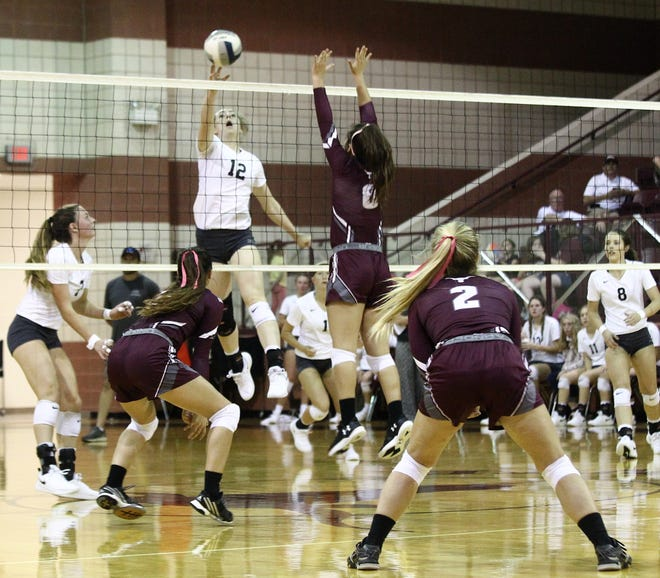 Water Valley's Kalysta Minton-Holland (12) taps the ball over the net past Bronte's Karissa Cervenka (8) during a District 7-2A volleyball match Oct. 6, 2018, at Bronte High School.