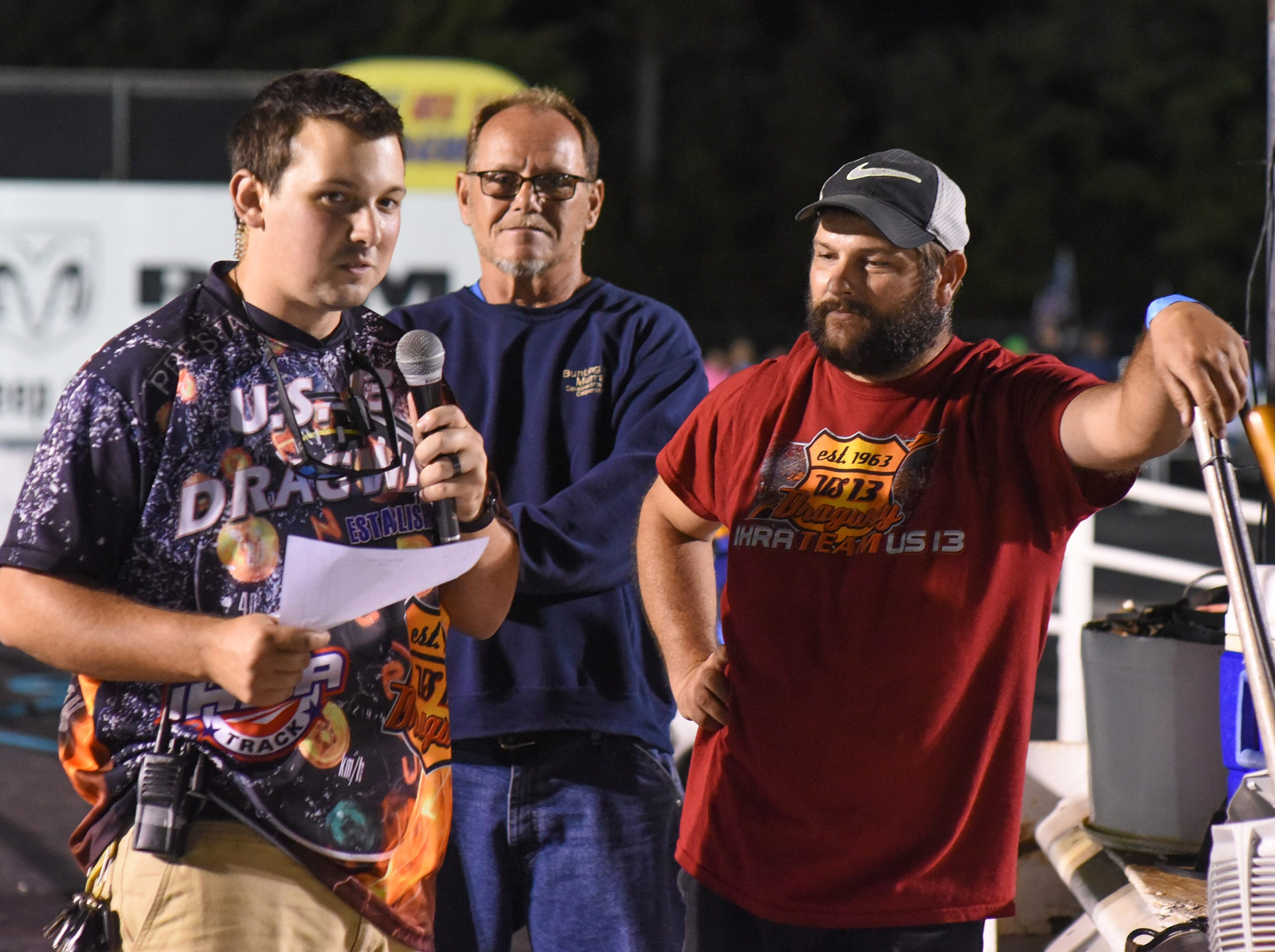 A track announcer ask the crowd for who the winner was at the first Endless Summer Cruisin' 2018 Burnout Contest at the U.S. 13 Dragway in Delmar. Billy McLamb, right, of Mardela Springs was the winner of the contest and $500 sponsored by Special Event Productions Inc. (Photo by Todd Dudek for The Daily Times)