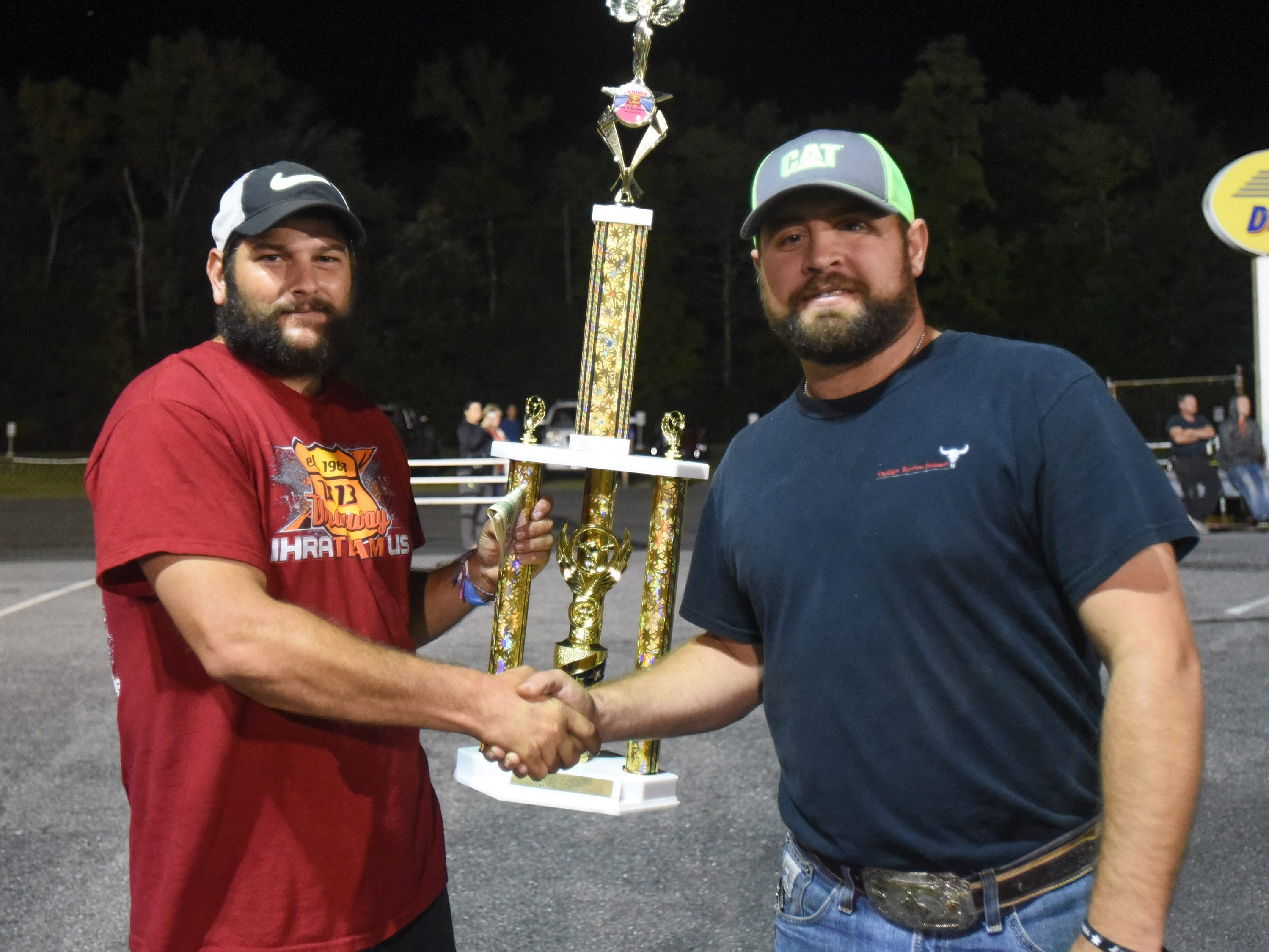 Billy McLamb accepts the First Place trophy and $500 from T.J. Torres with Special Events Productions after winning the first Endless Summer Cruisin' 2018 Burnout Contest at the U.S. 13 Dragway in Delmar.   (Photo by Todd Dudek for The Daily Times)