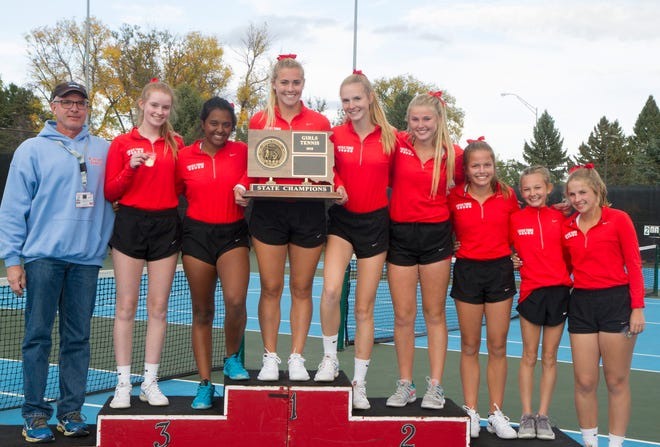 Lincoln won its third consecutive state tennis title Saturday in Rapid City.